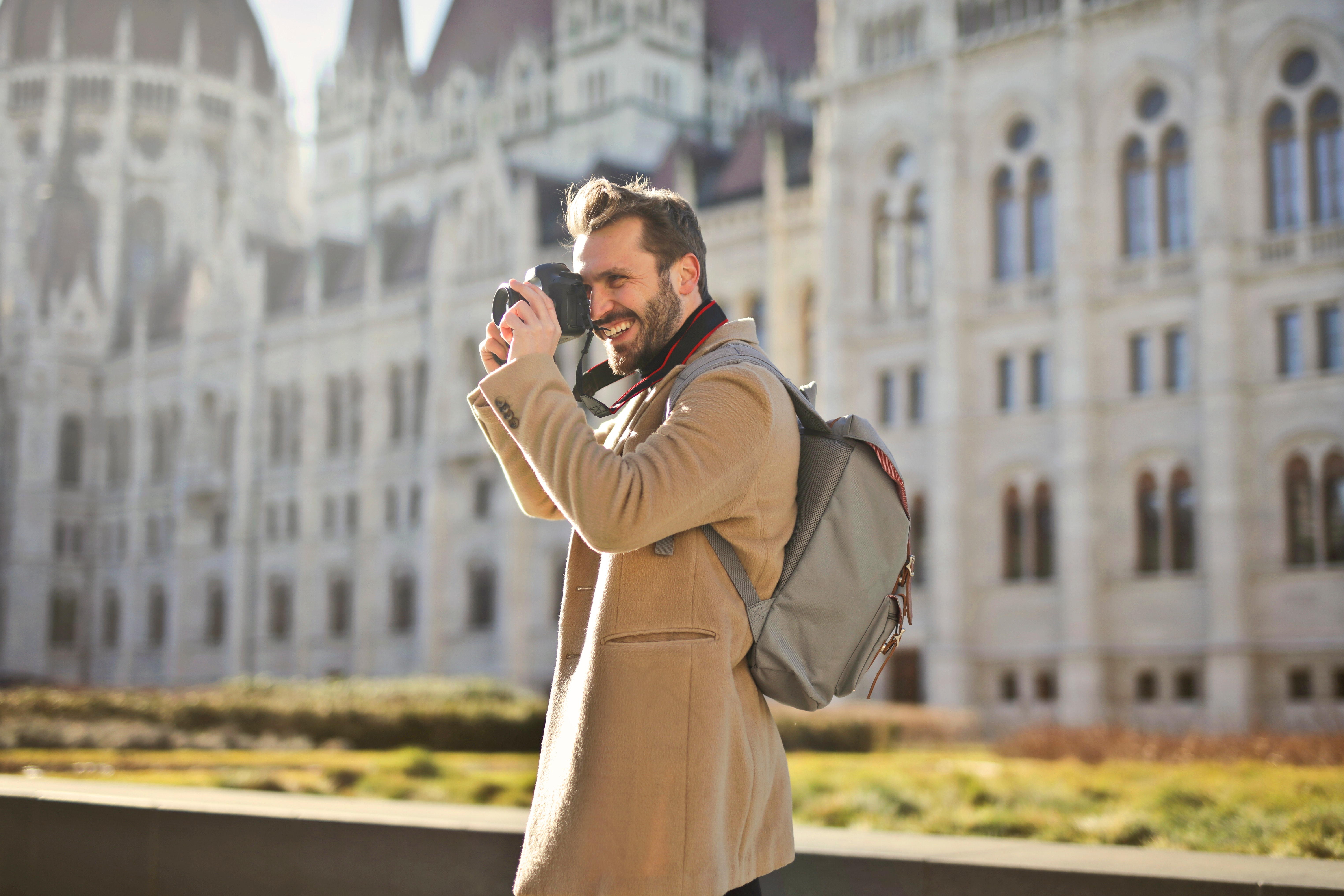 Man Holding and Capturing Images Around Him, Architecture, Smiling, Outside, Person, HQ Photo