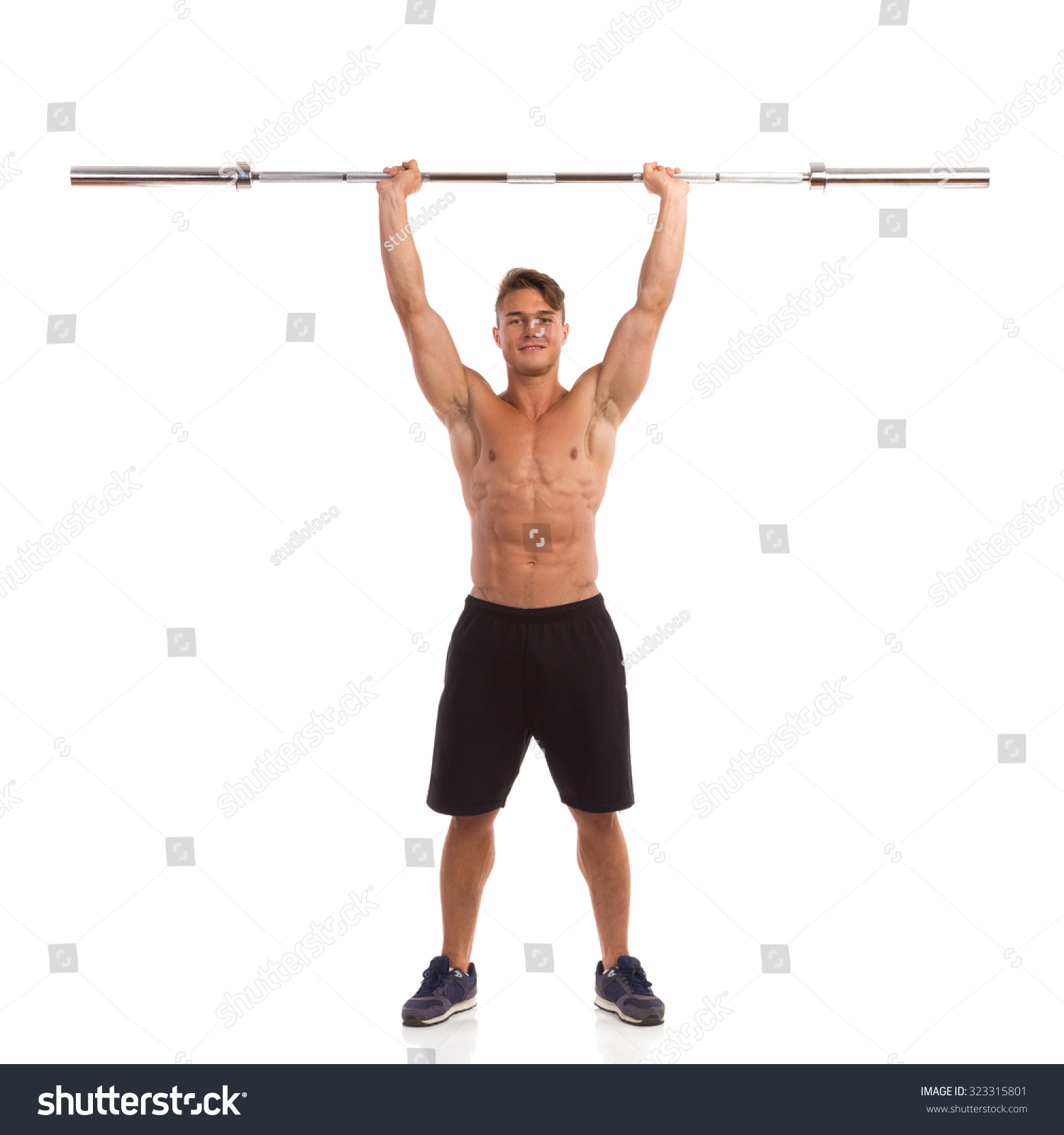 Fit Man Holding Barbell Over His Stock Photo (Royalty Free ...