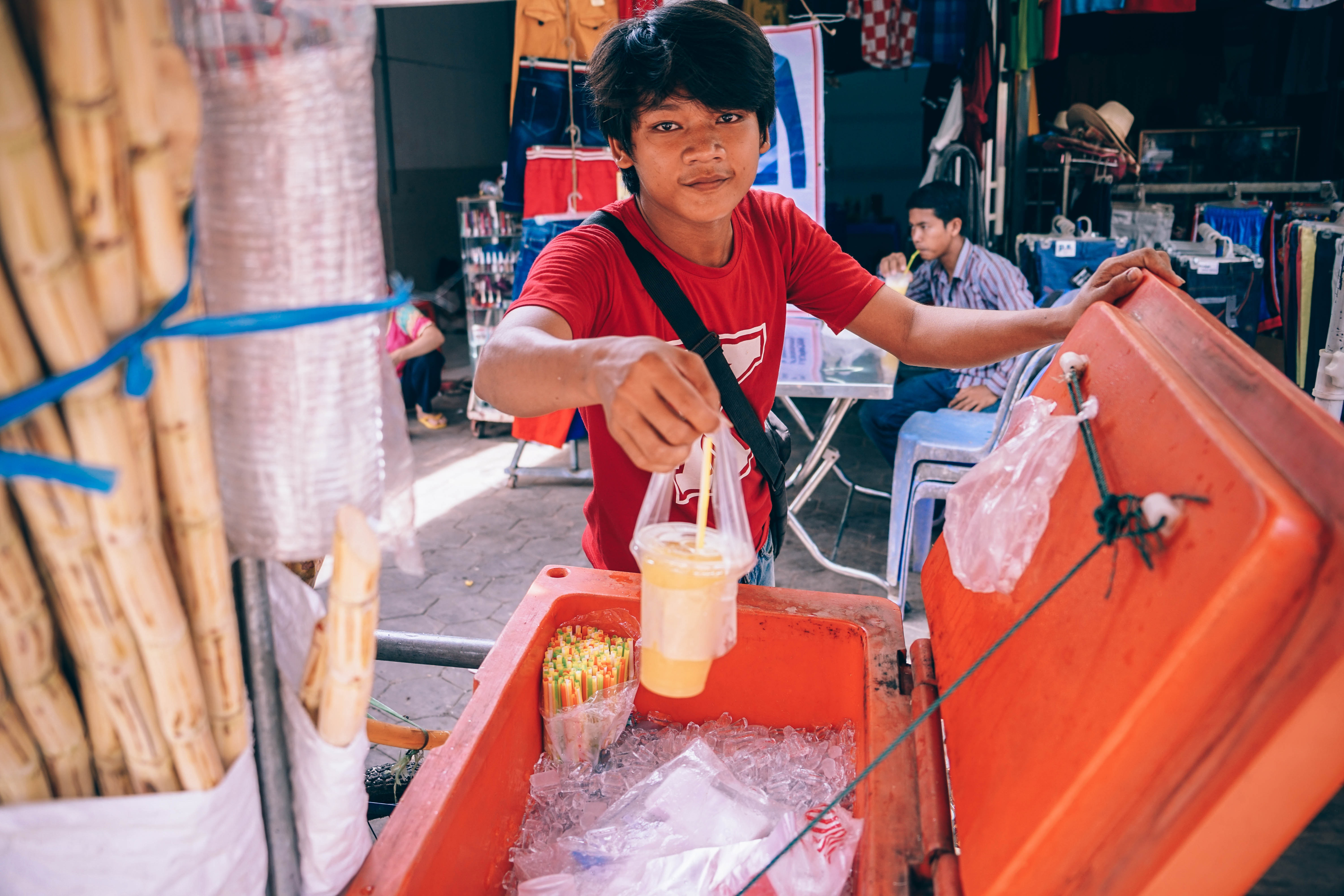 Man holding plastic cup photo