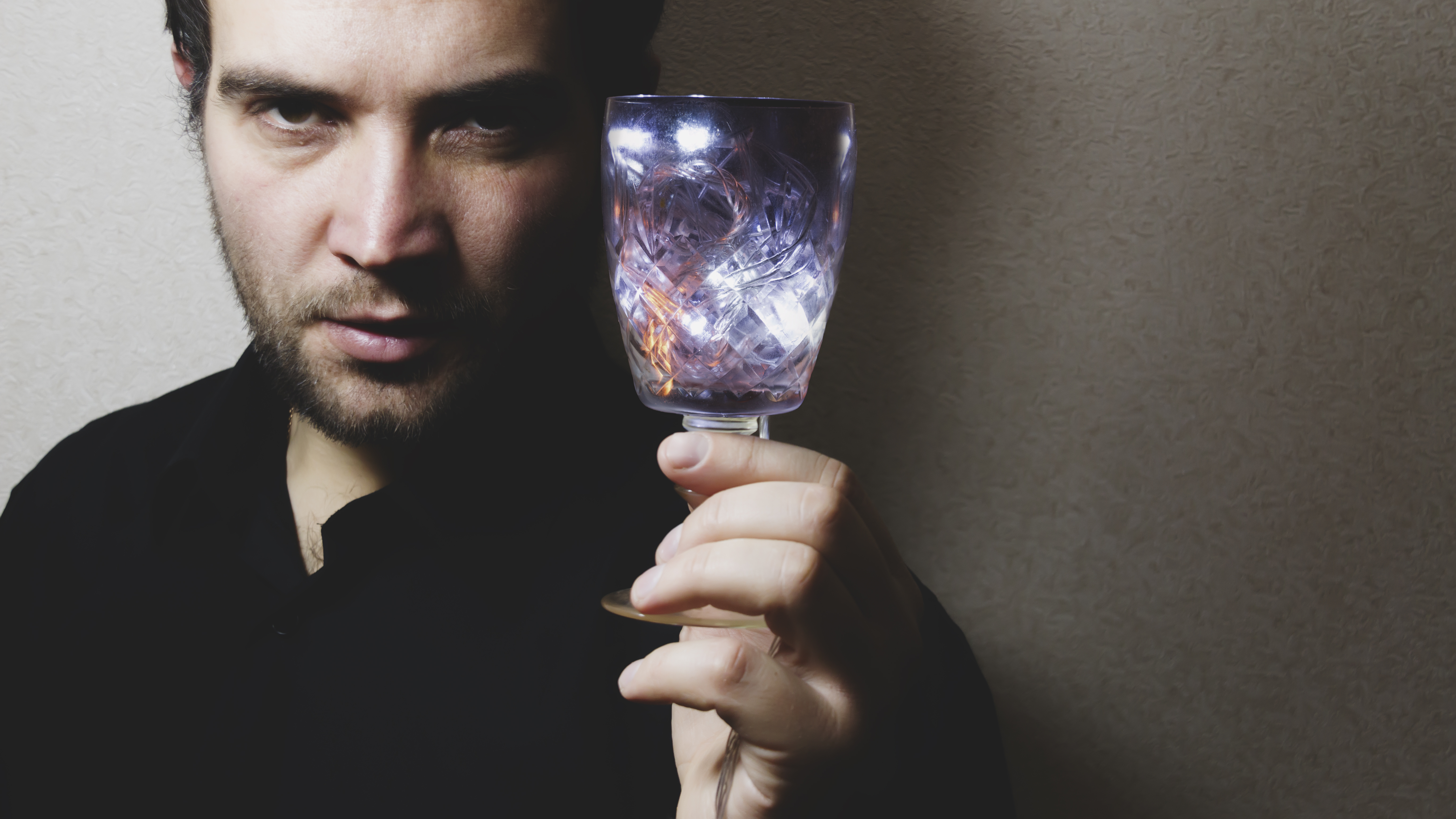 Man holding wine glass photo
