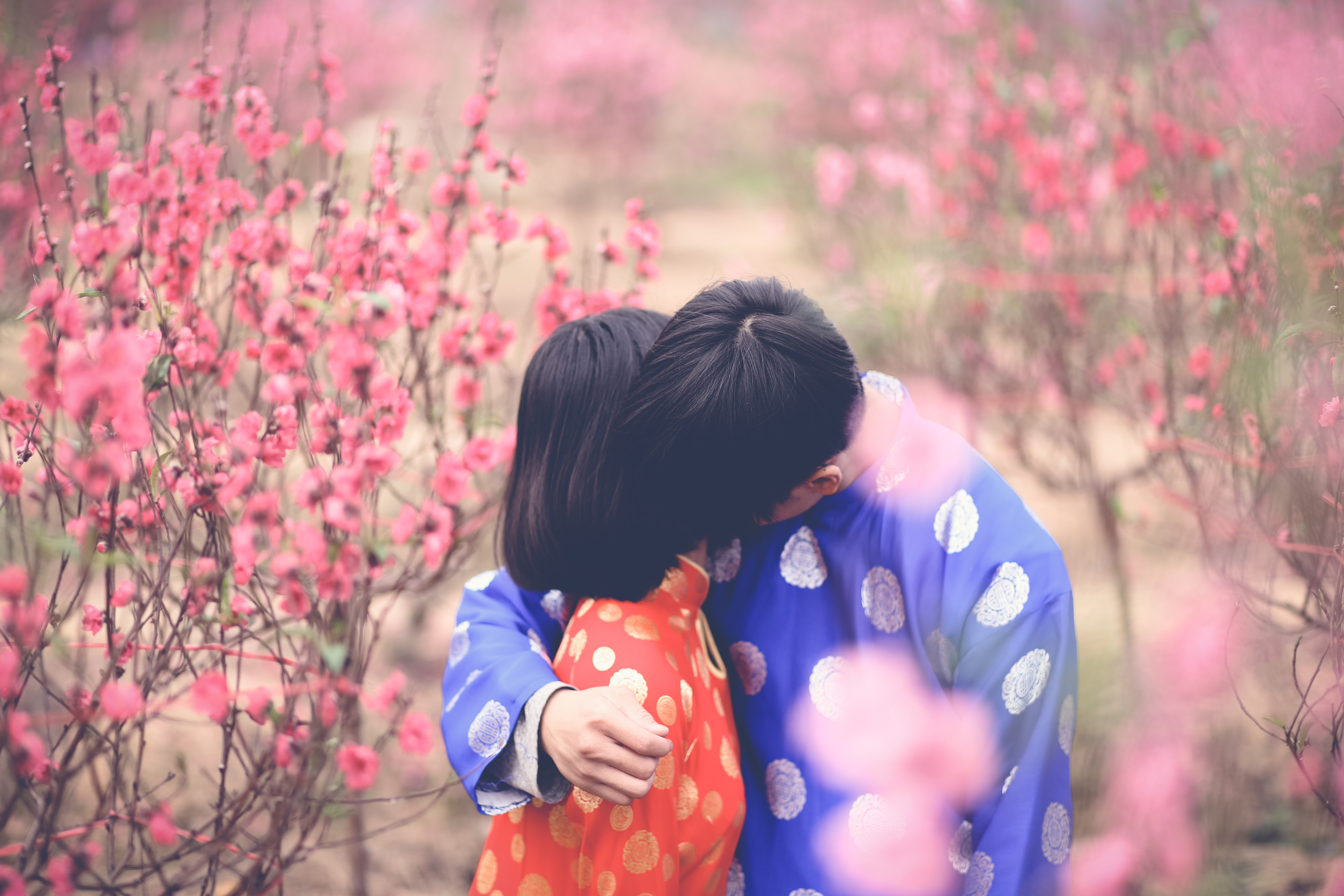 Man Hugging Girl in Orange Clothes, Blurred background, Outdoors, Young, Woman, HQ Photo