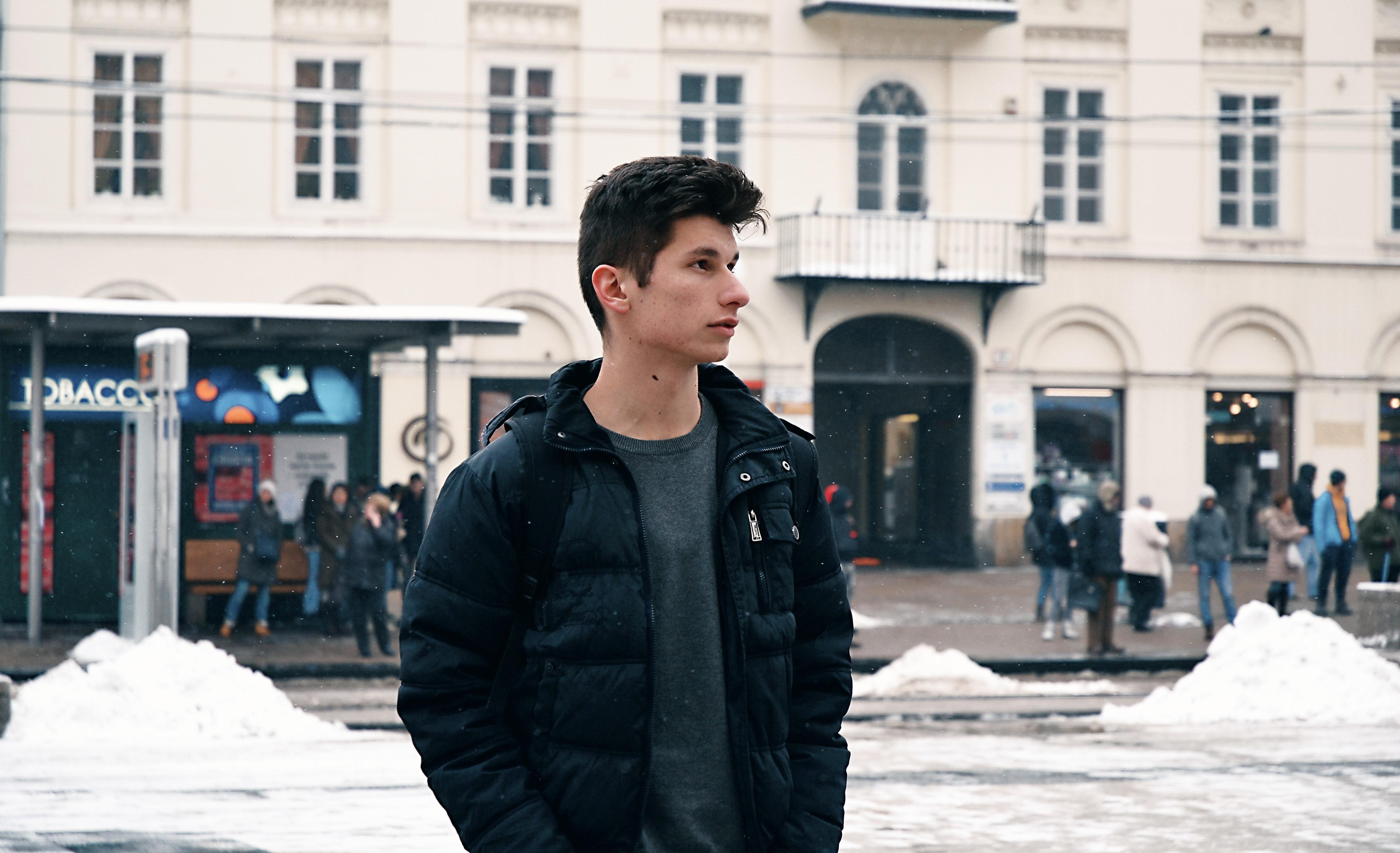 Man in black bubble full-zip jacket photo