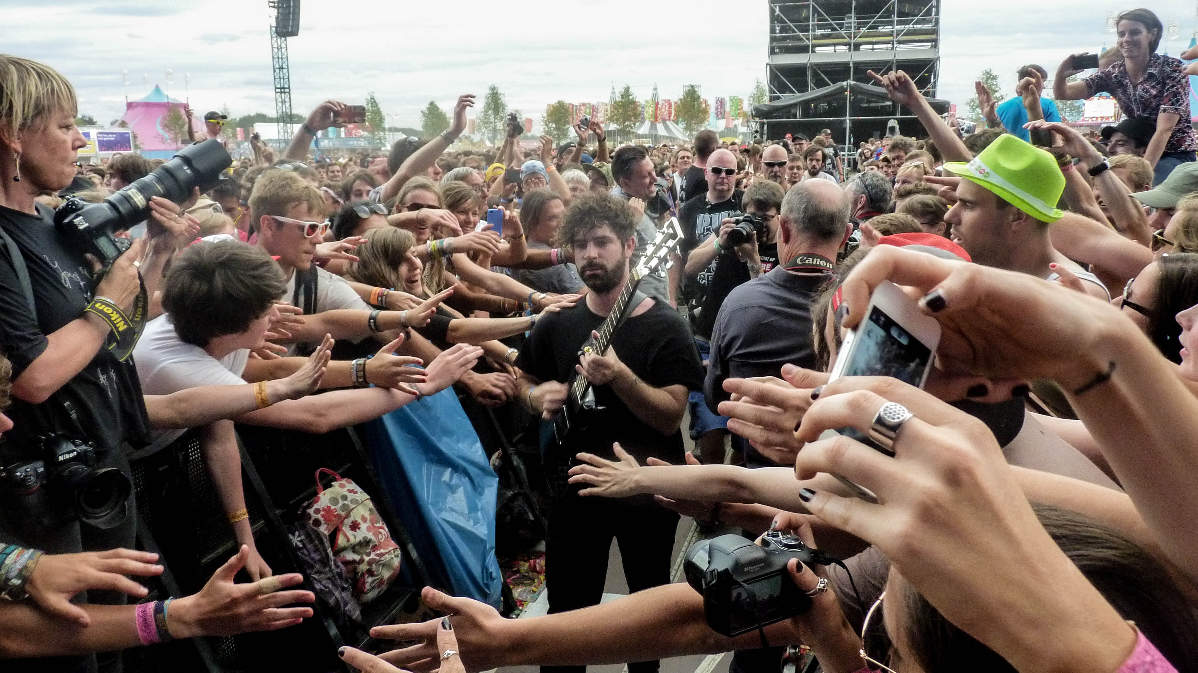 Man in Black Crew Neck T Shirt and Pants Playing Guitar Surrounded by Crowd, Audience, Band, Concert, Crowd, HQ Photo