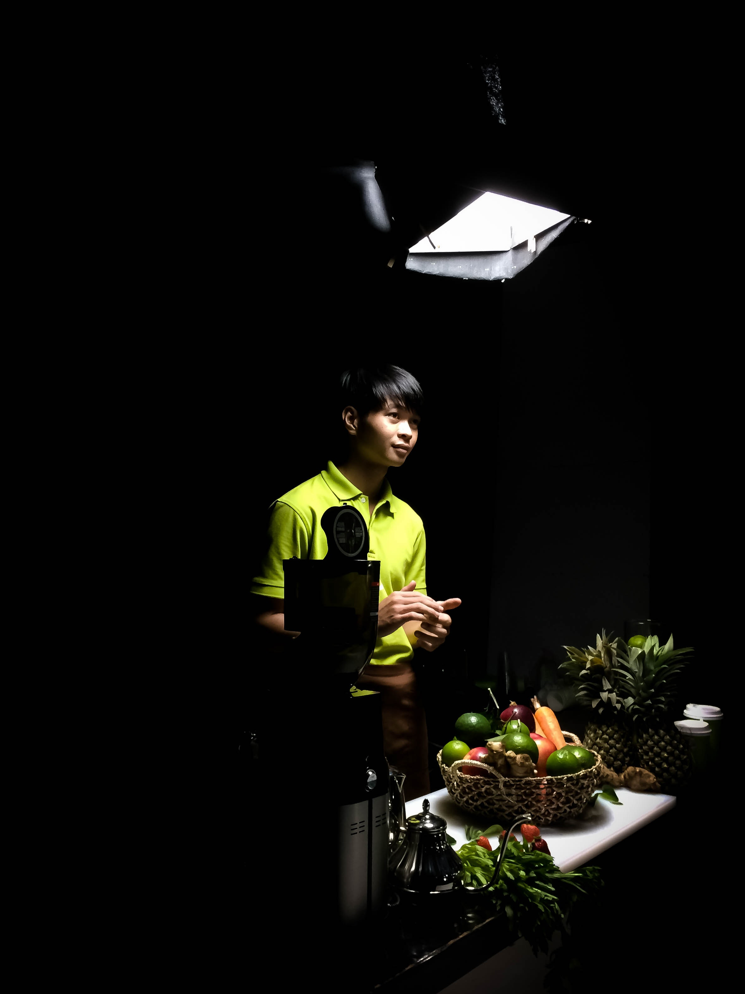 Man in green polo shirt standing photo