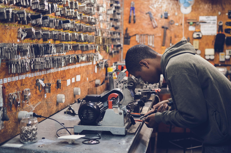 Man in Grey Hoodie Jacket Holding Black Metal Near White Socket Power Supply, Craftsman, Equipment, Handmade, Job, HQ Photo