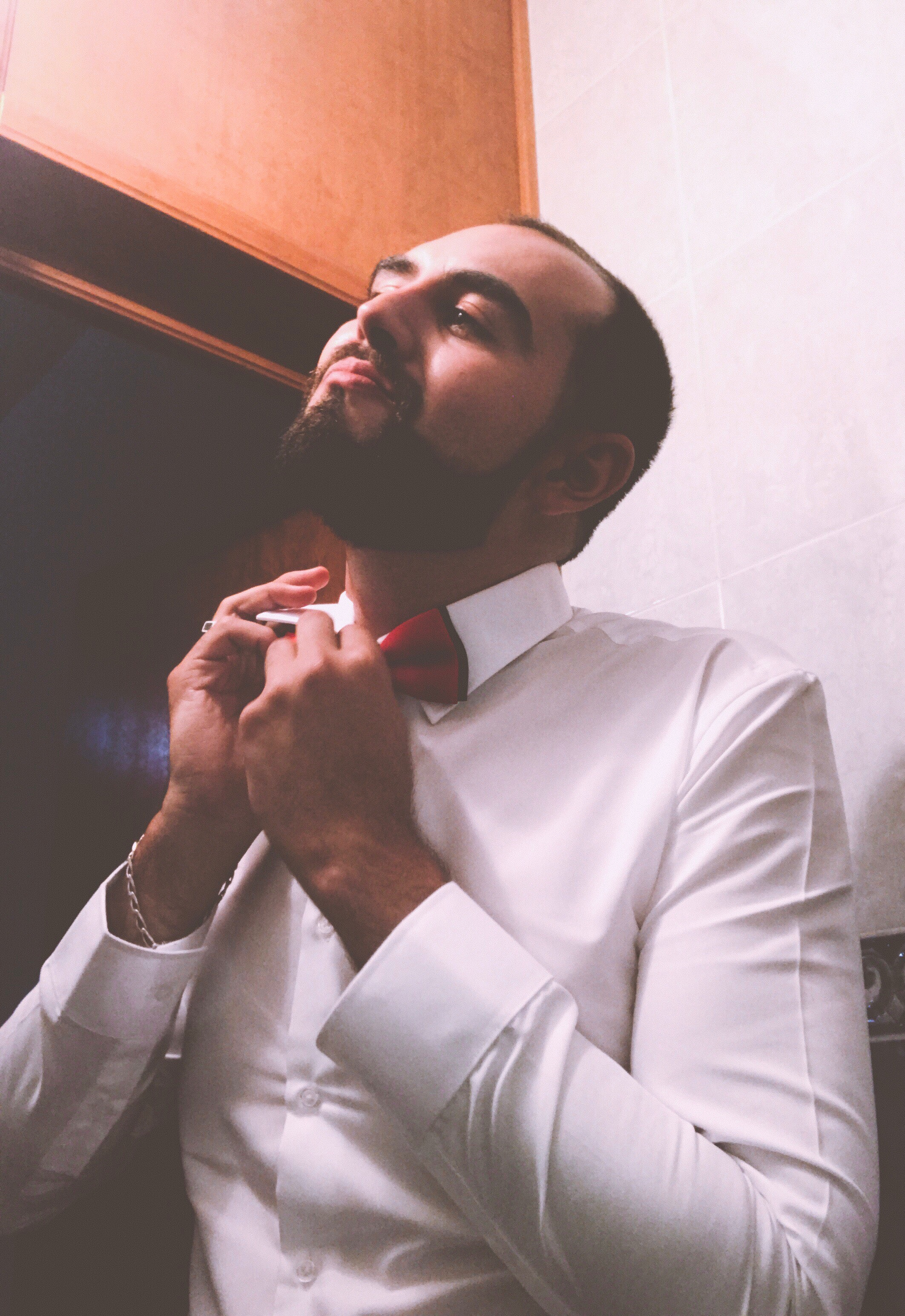 Man in White Dress Shirt Tying a Red Bow Tie, Adult, Guy, Pose, Photoshoot, HQ Photo