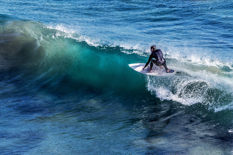 Man in white surfboard photo