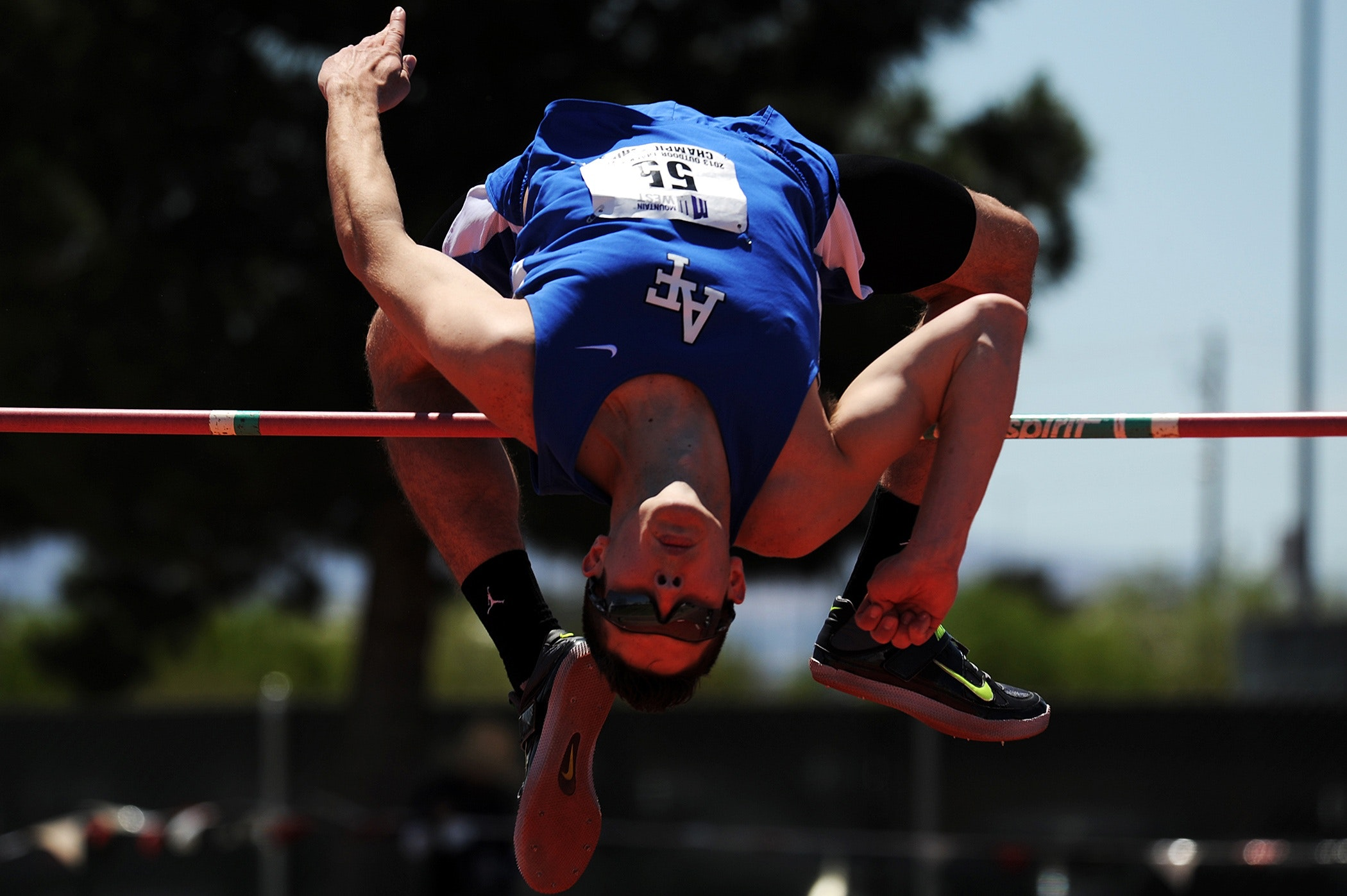 Man Jumping over Red Rod, Action, Jump, Sunglasses, Person, HQ Photo