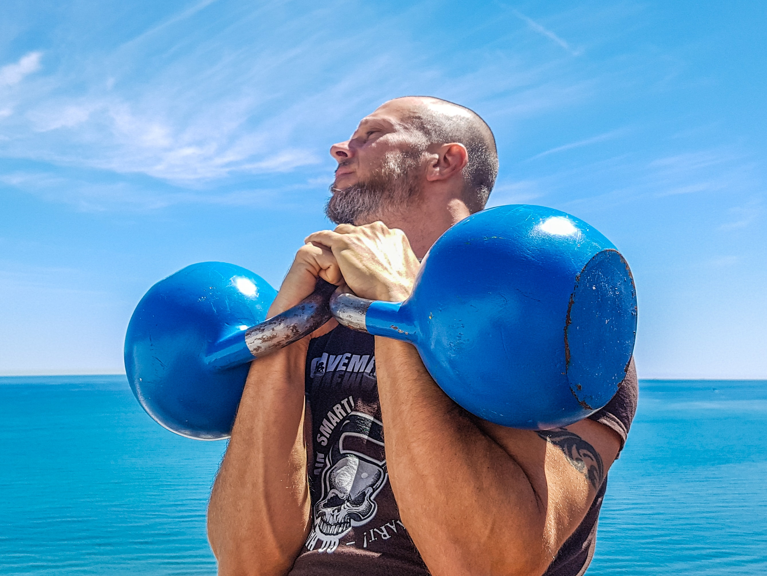 Man Lifting Pair of Blue Kettlebells, Active, Muscles, Strong, Sky, HQ Photo