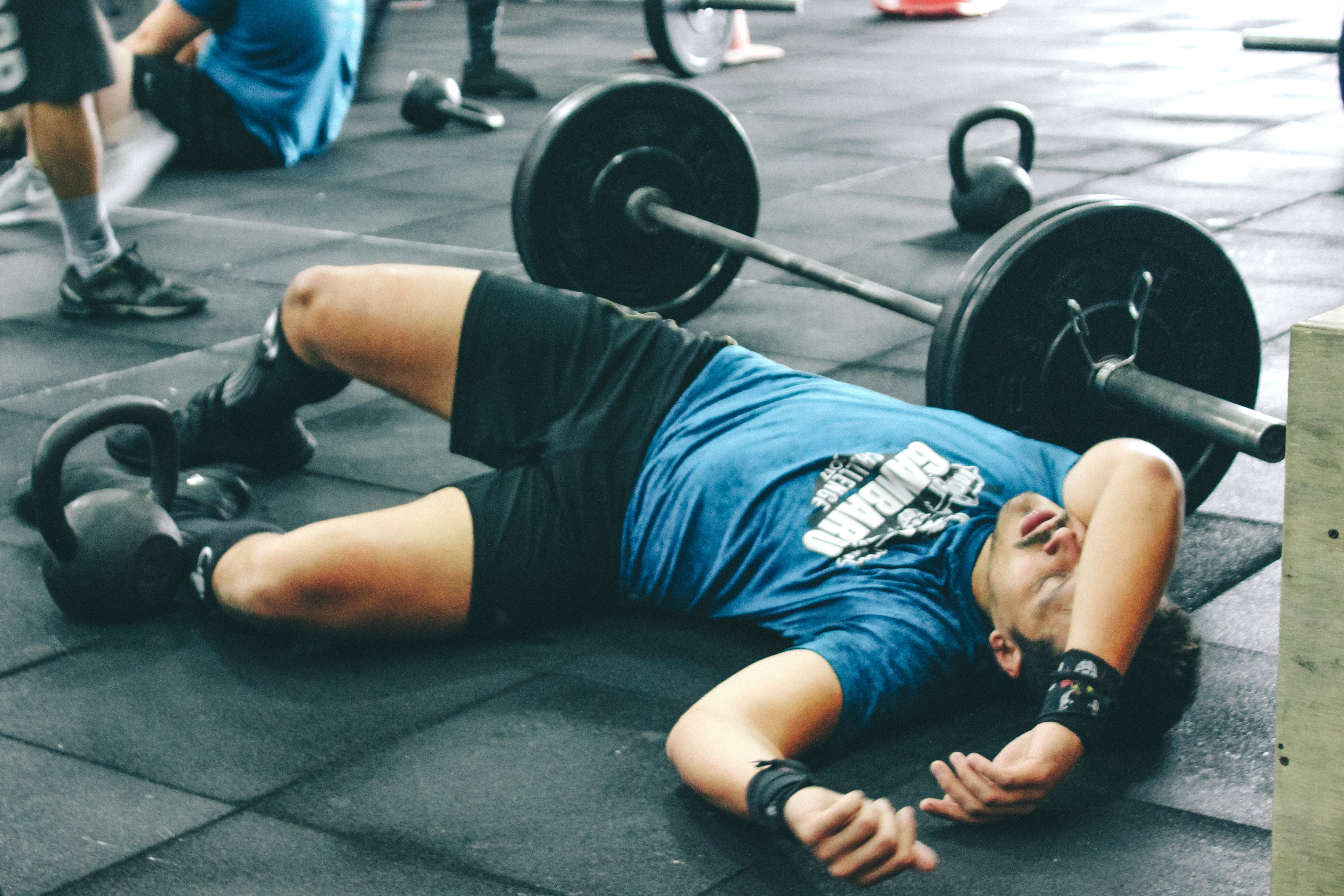 Man Lying on Rubber Mat Near Barbell Inside the Gym, Activity, Male, Weights, Weightlifting, HQ Photo
