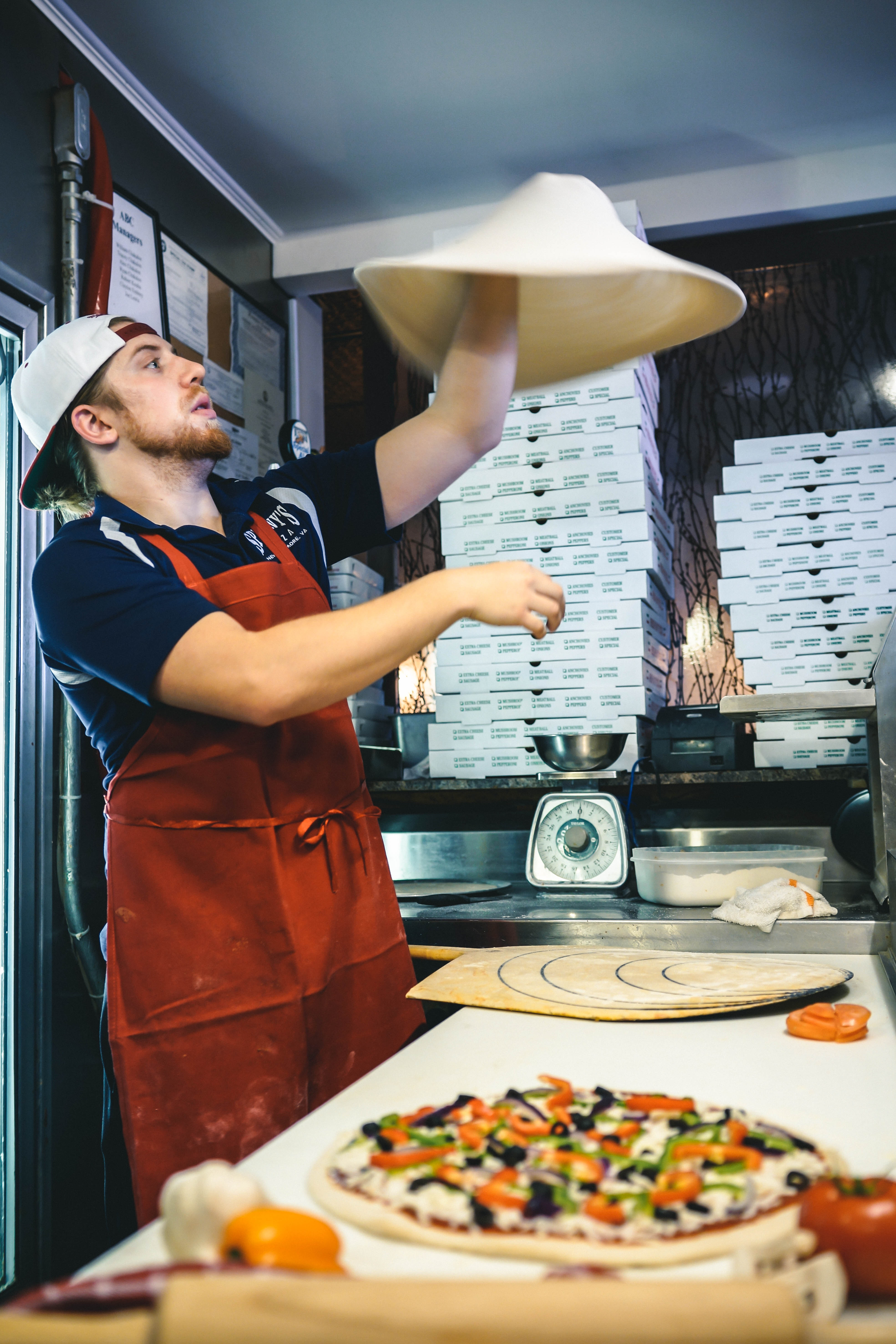Man making pizza dough photo