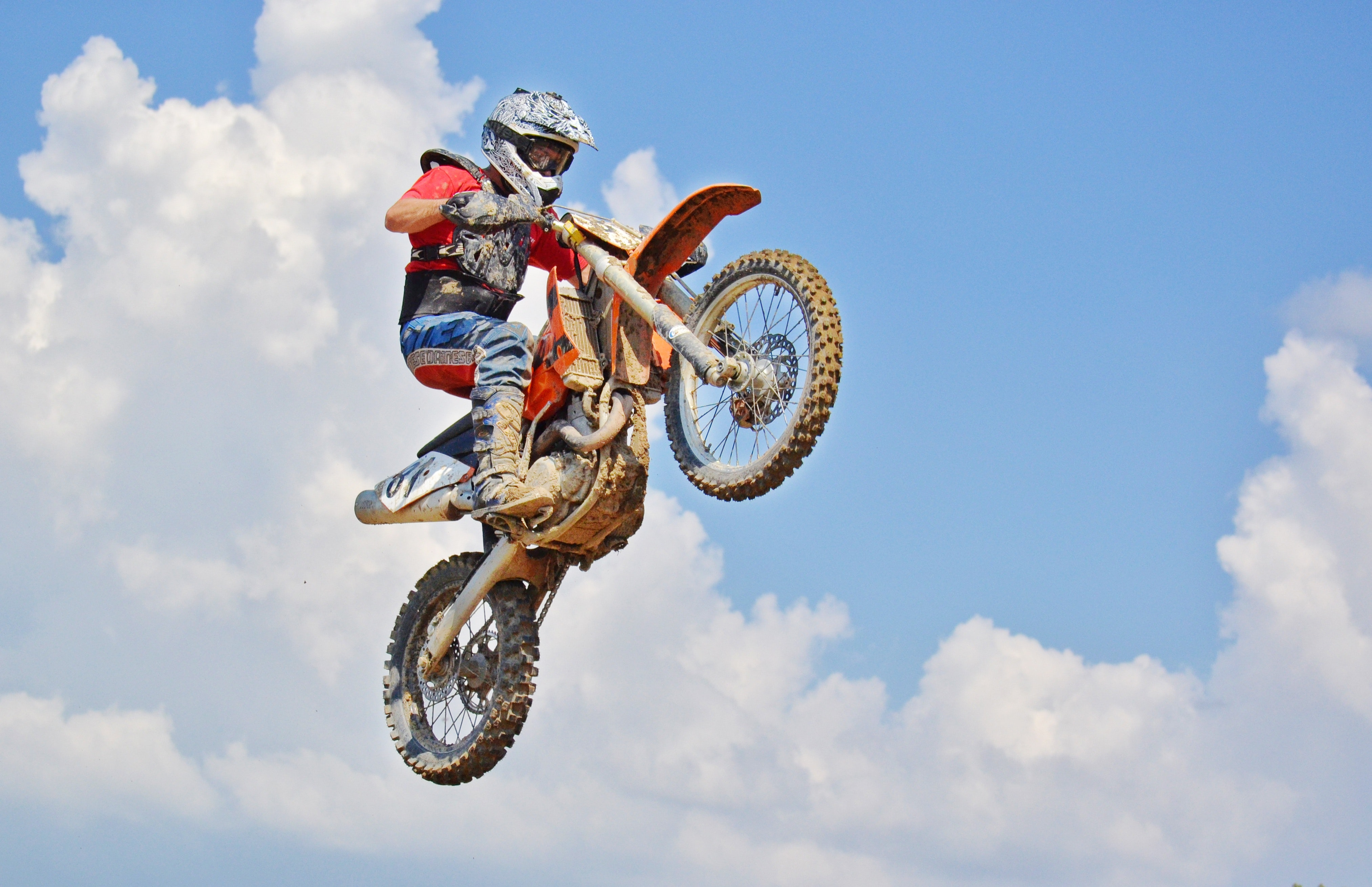 Man on a motocross dirt bike photo