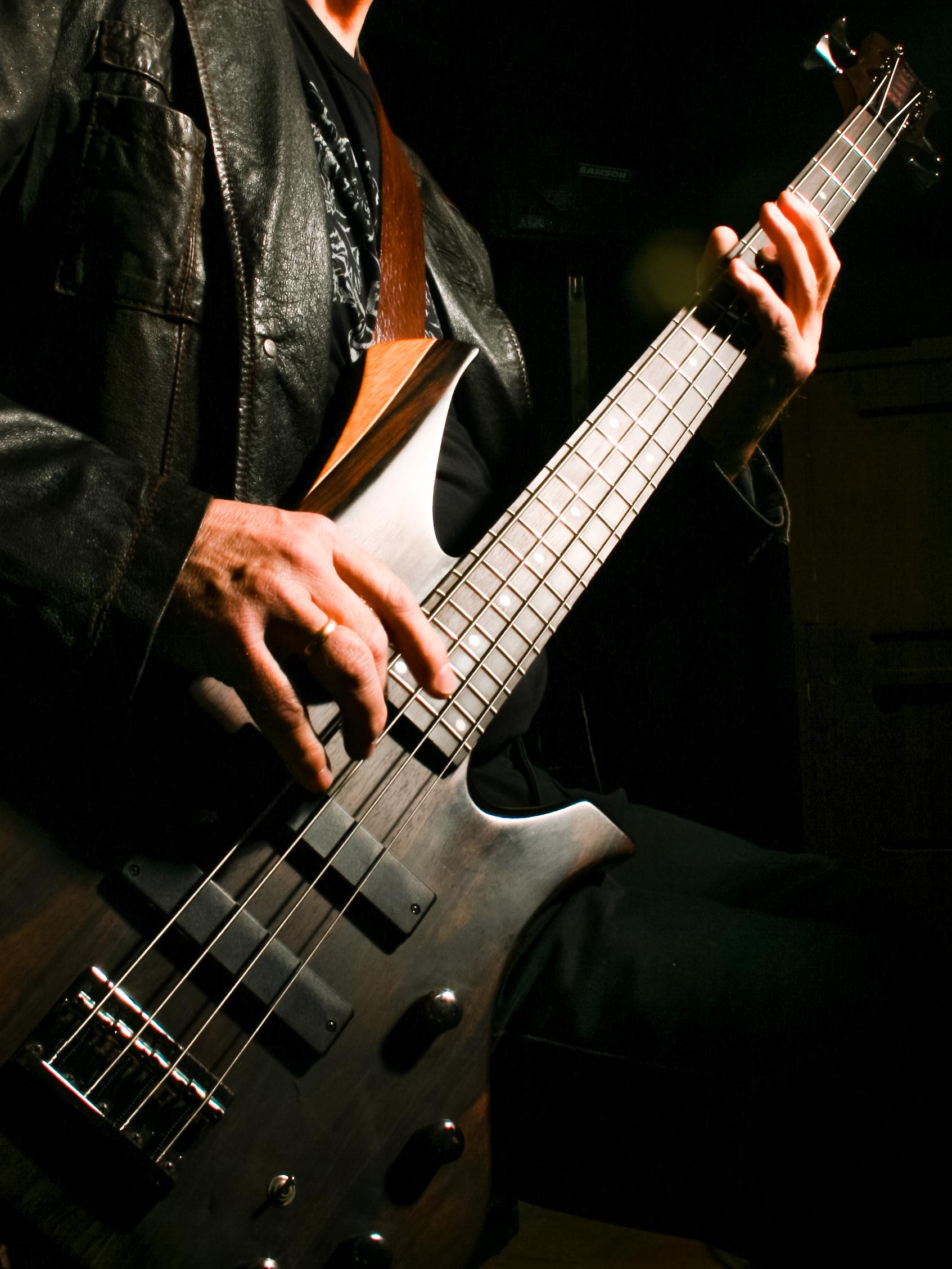 Man playing electric bass photo