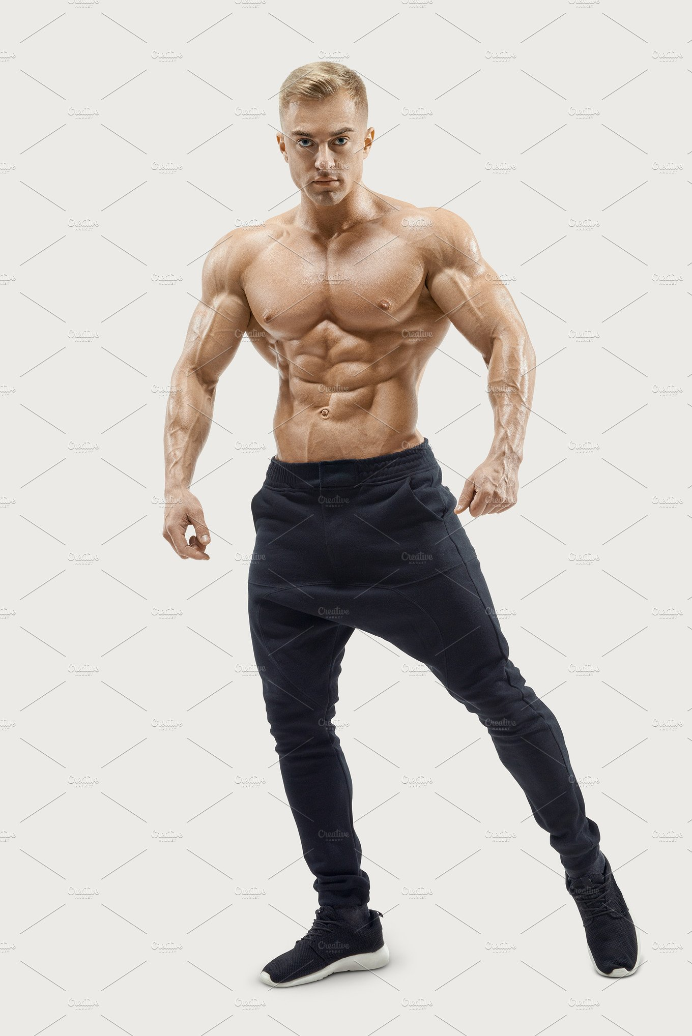 Young fitness male model posing ~ Sports Photos ~ Creative Market