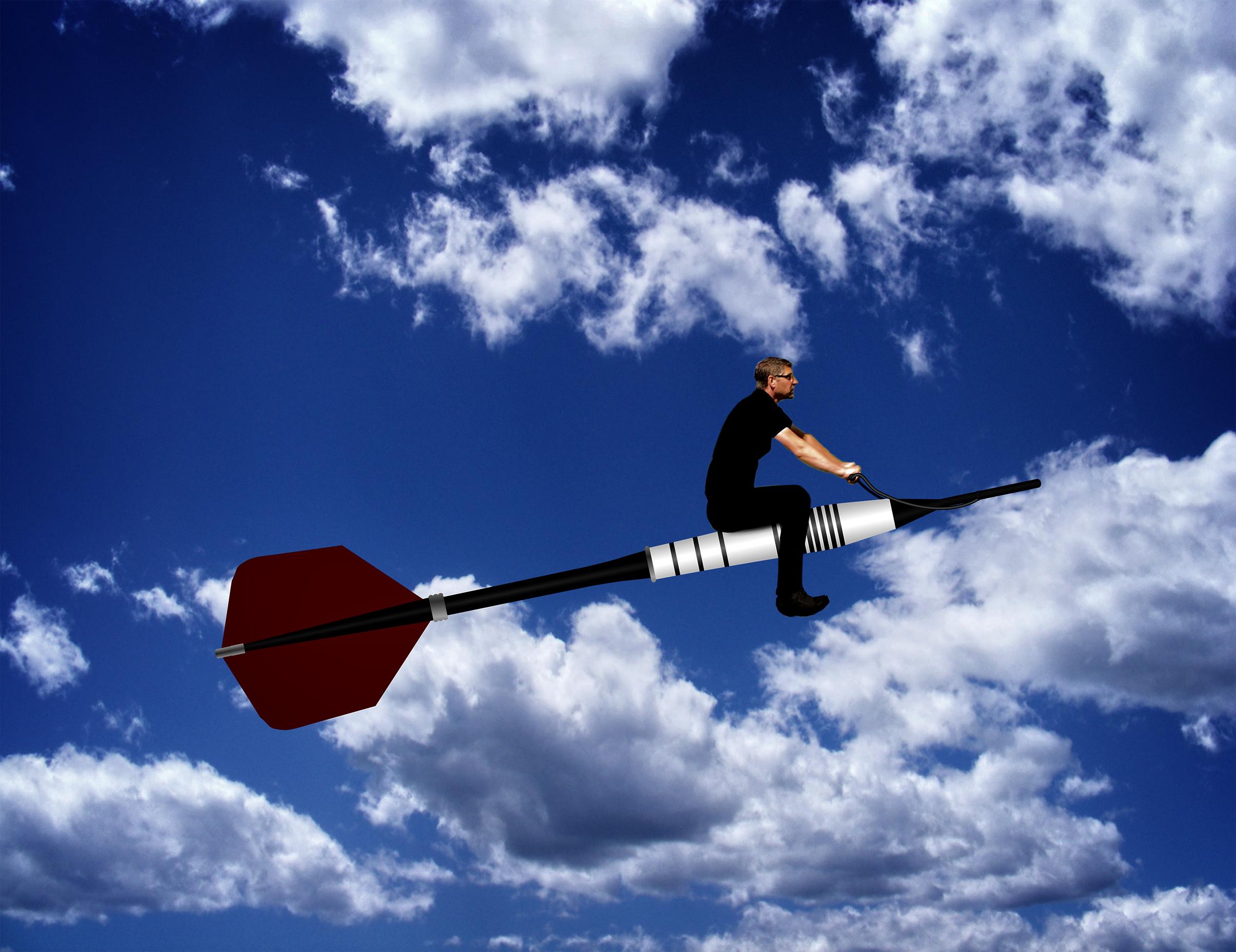 Man riding a dart through the sky photo