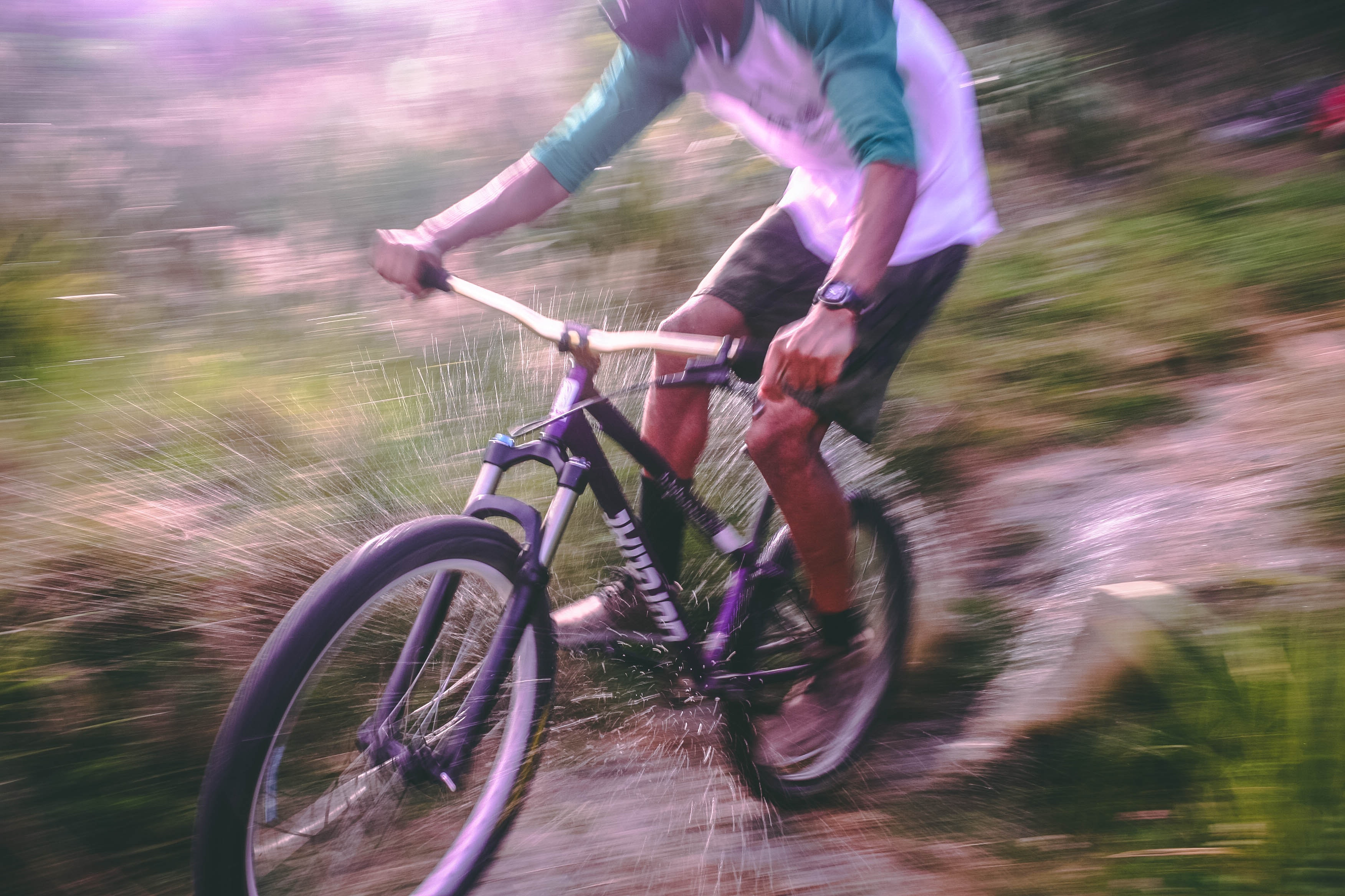 Man riding black and white hardtail mountain bike photo