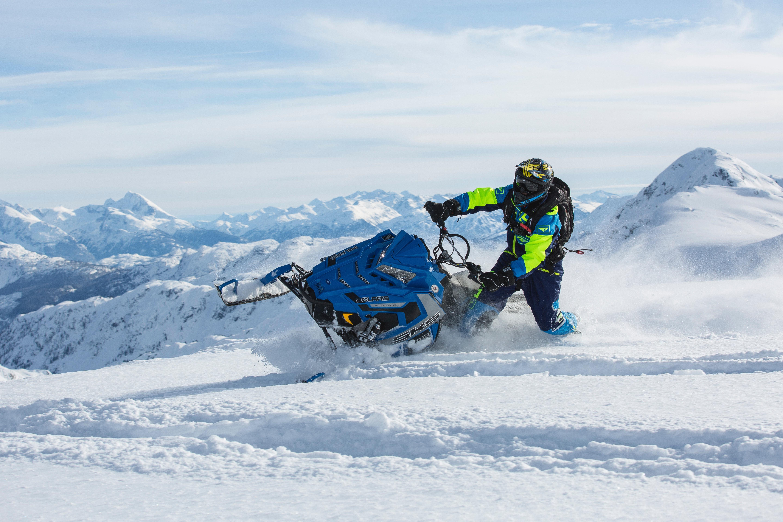 Man riding blue snow ski scooter photo
