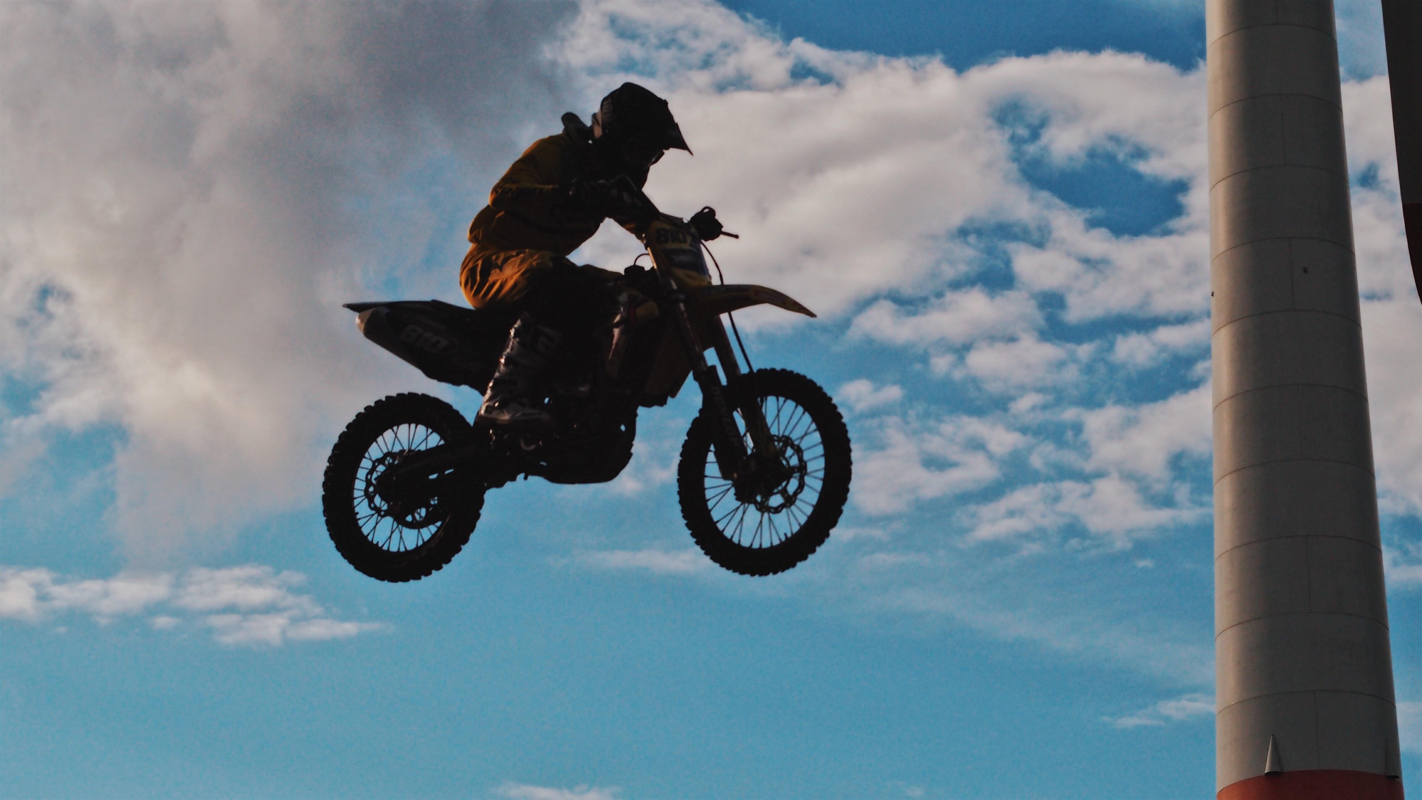 Man riding motocross dirt bike photo