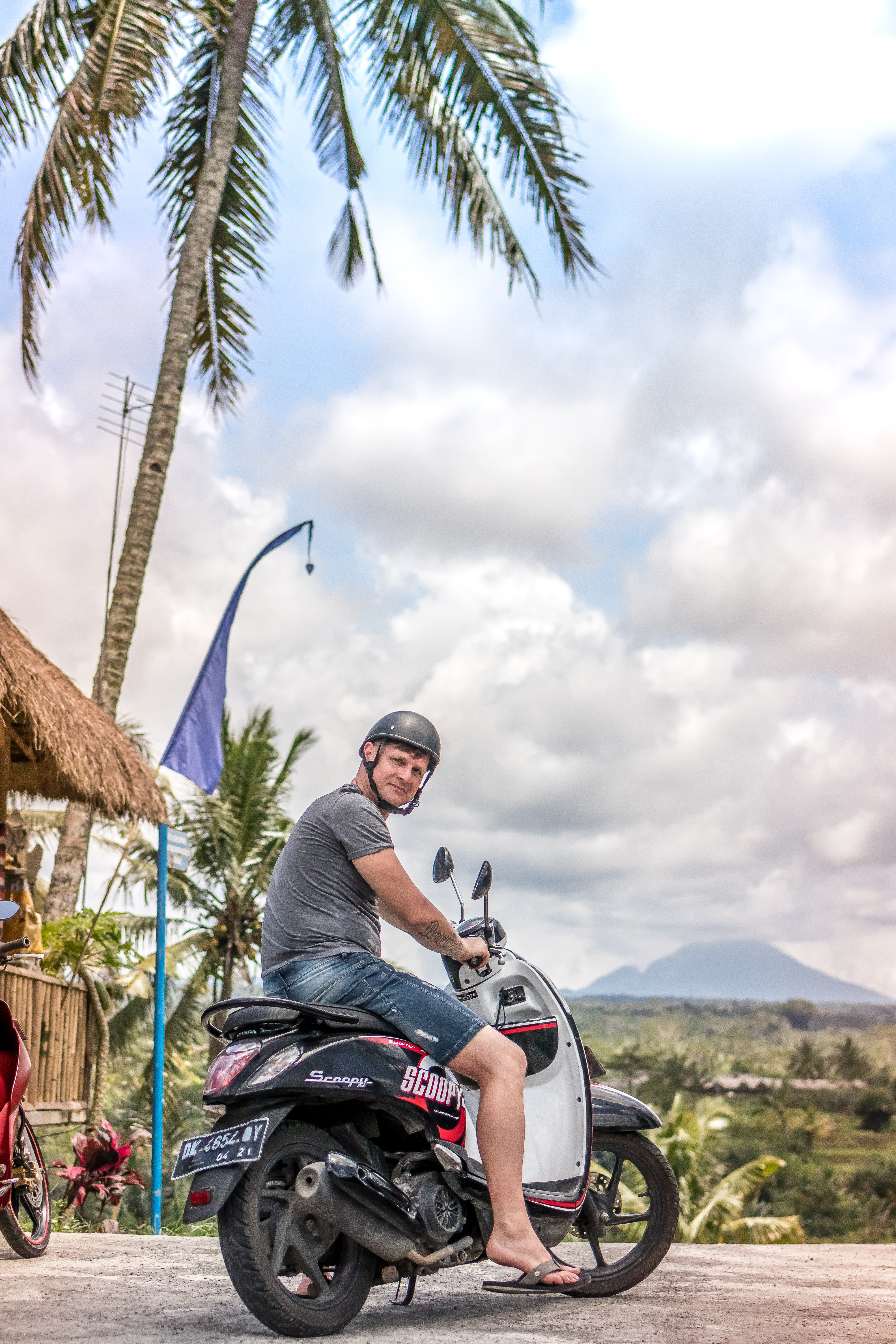 Man riding motor scooter photo