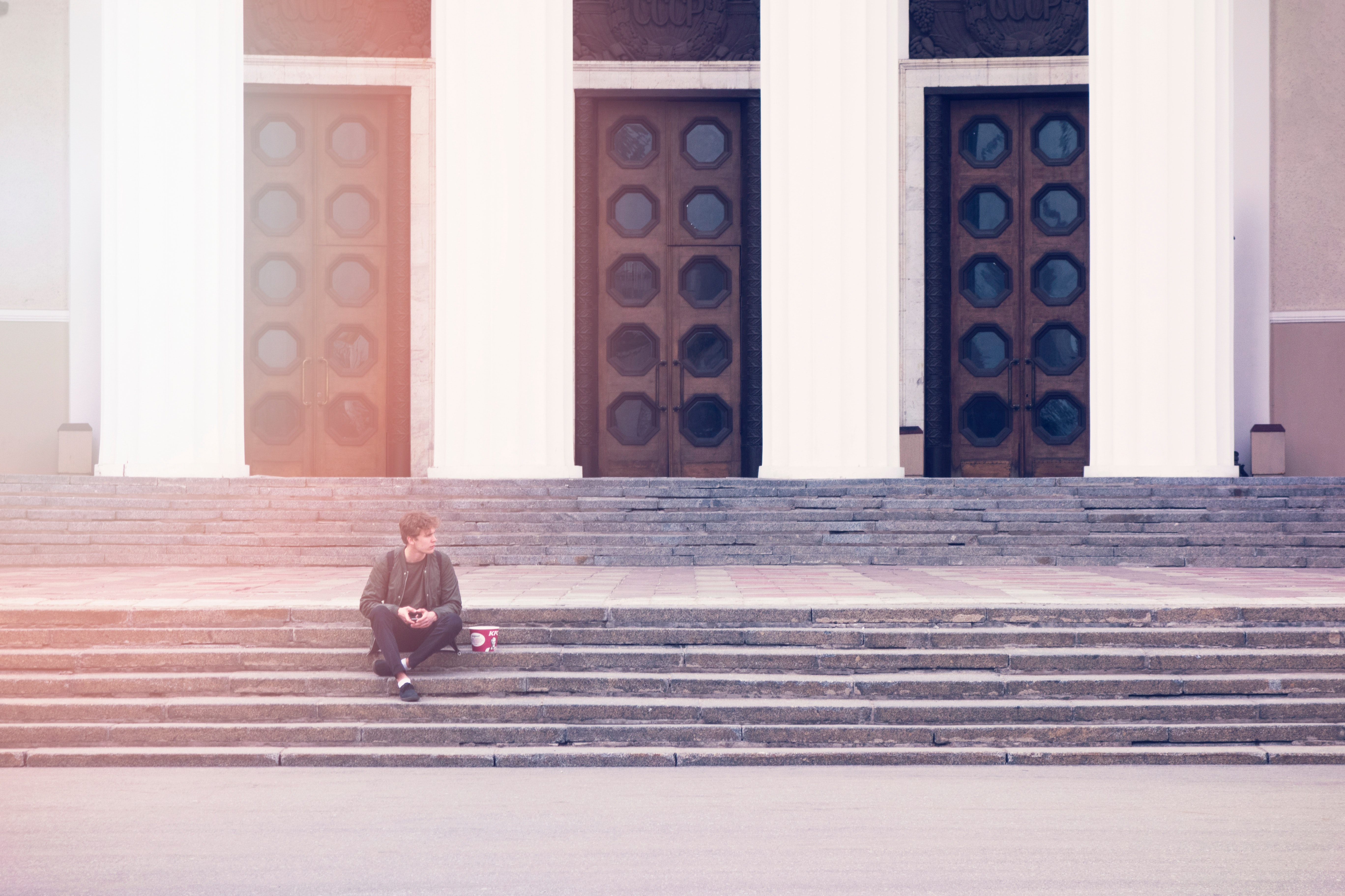 Man Sitting On A Concrete Stair Waiting For Someone During Daytime