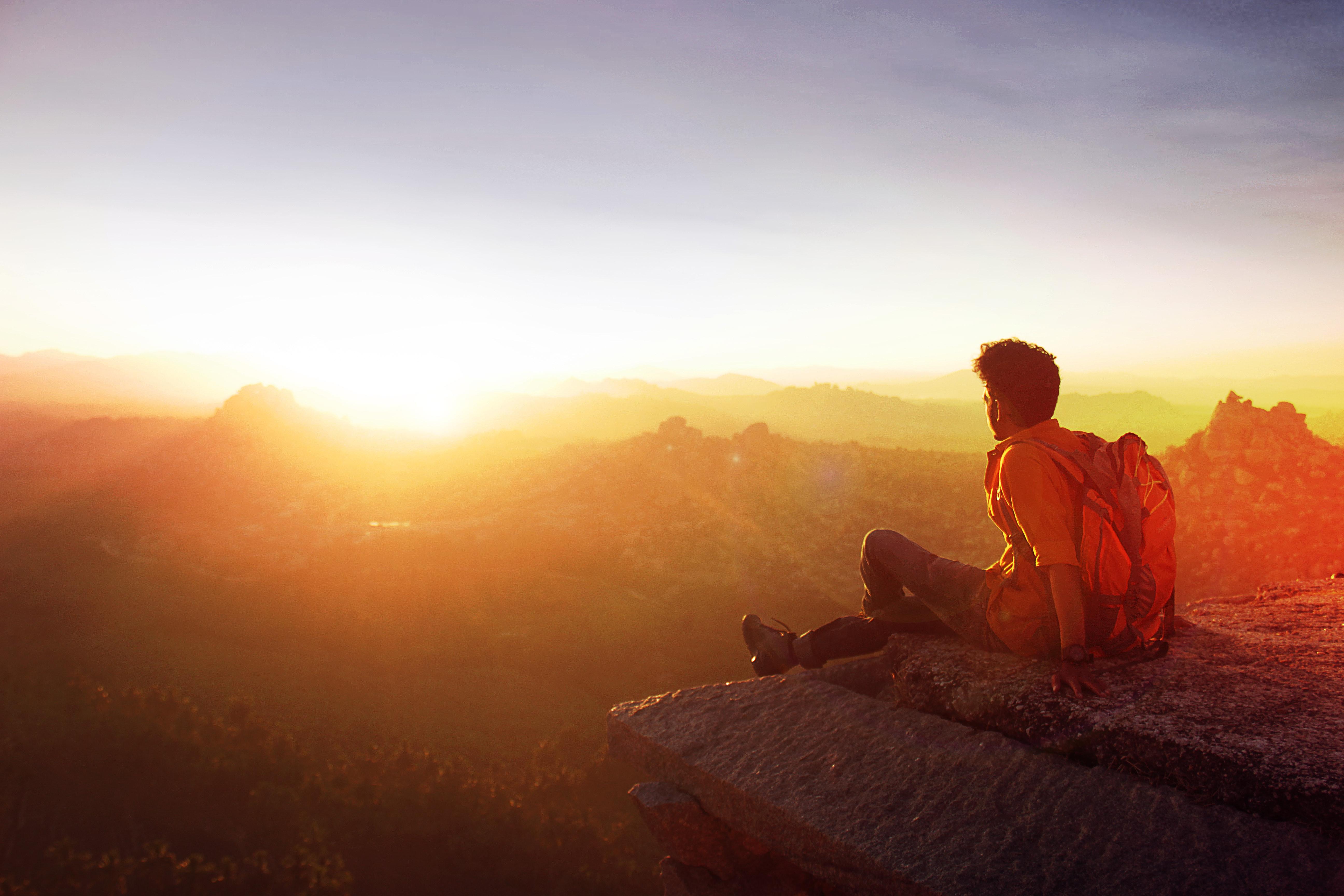 Man Sitting on Edge Facing Sunset, Adult, Mountains, Sunset, Sunrise, HQ Photo