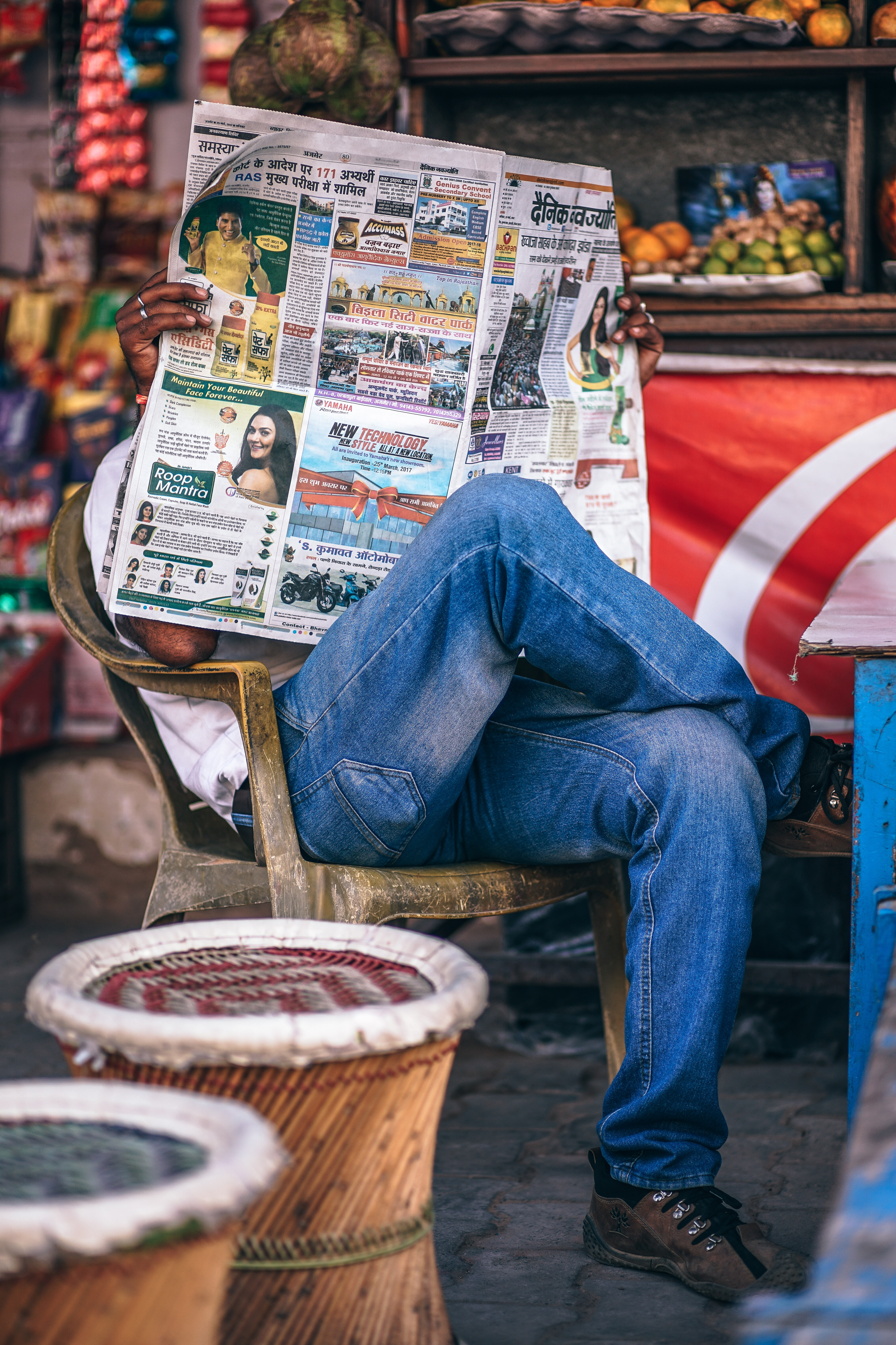 Man Sitting on Plastic Armchair Reading Newspaper, Adult, Sell, Outdoors, Paper, HQ Photo