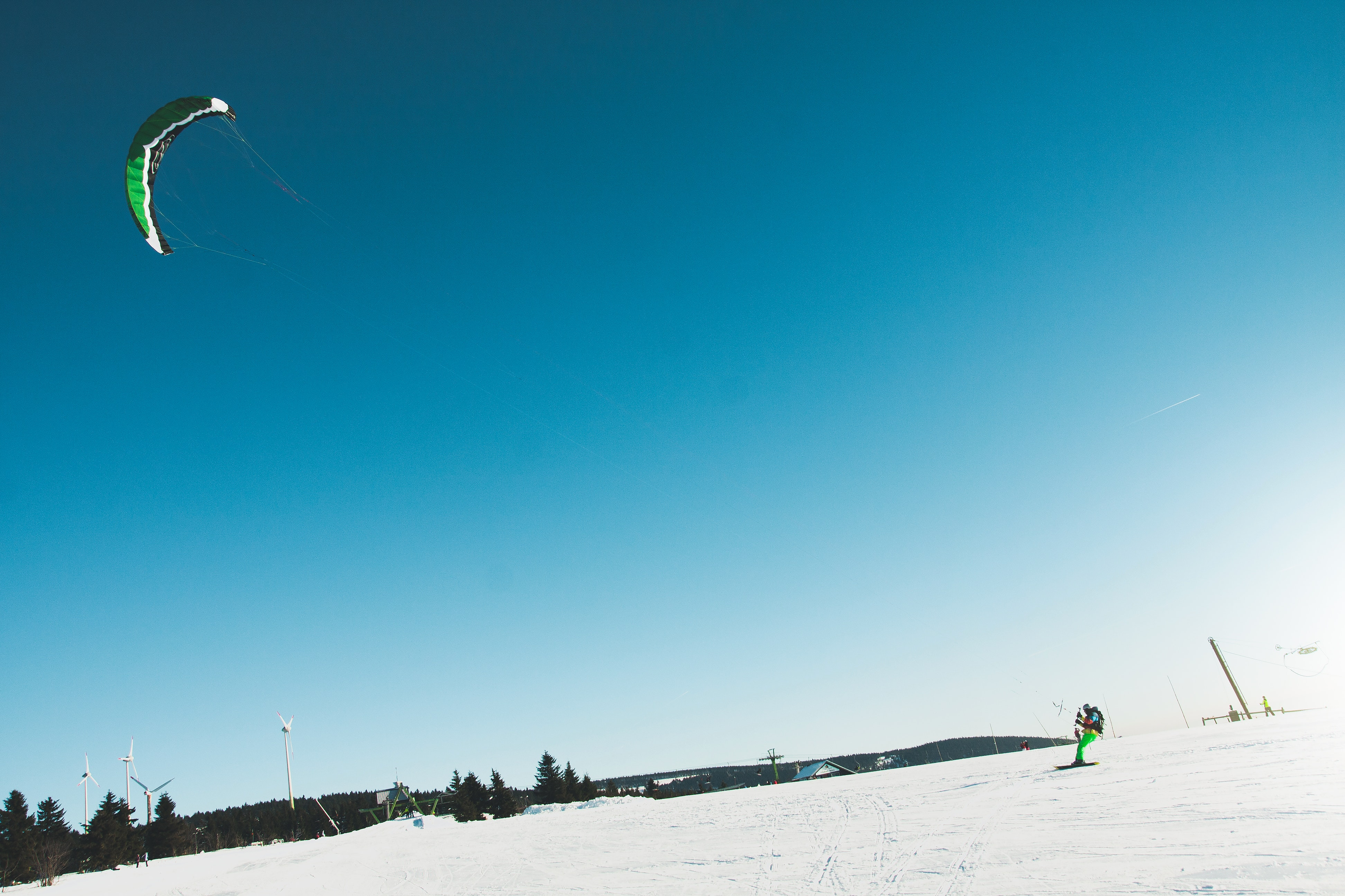 Man skiing on snow covered landscape photo