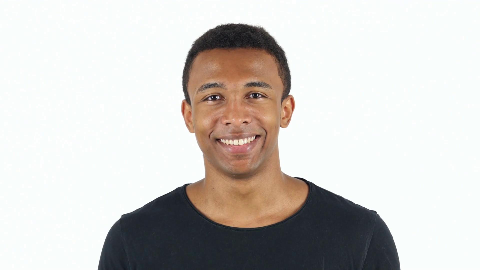 Smiling Black Man on White Background Stock Video Footage - Videoblocks