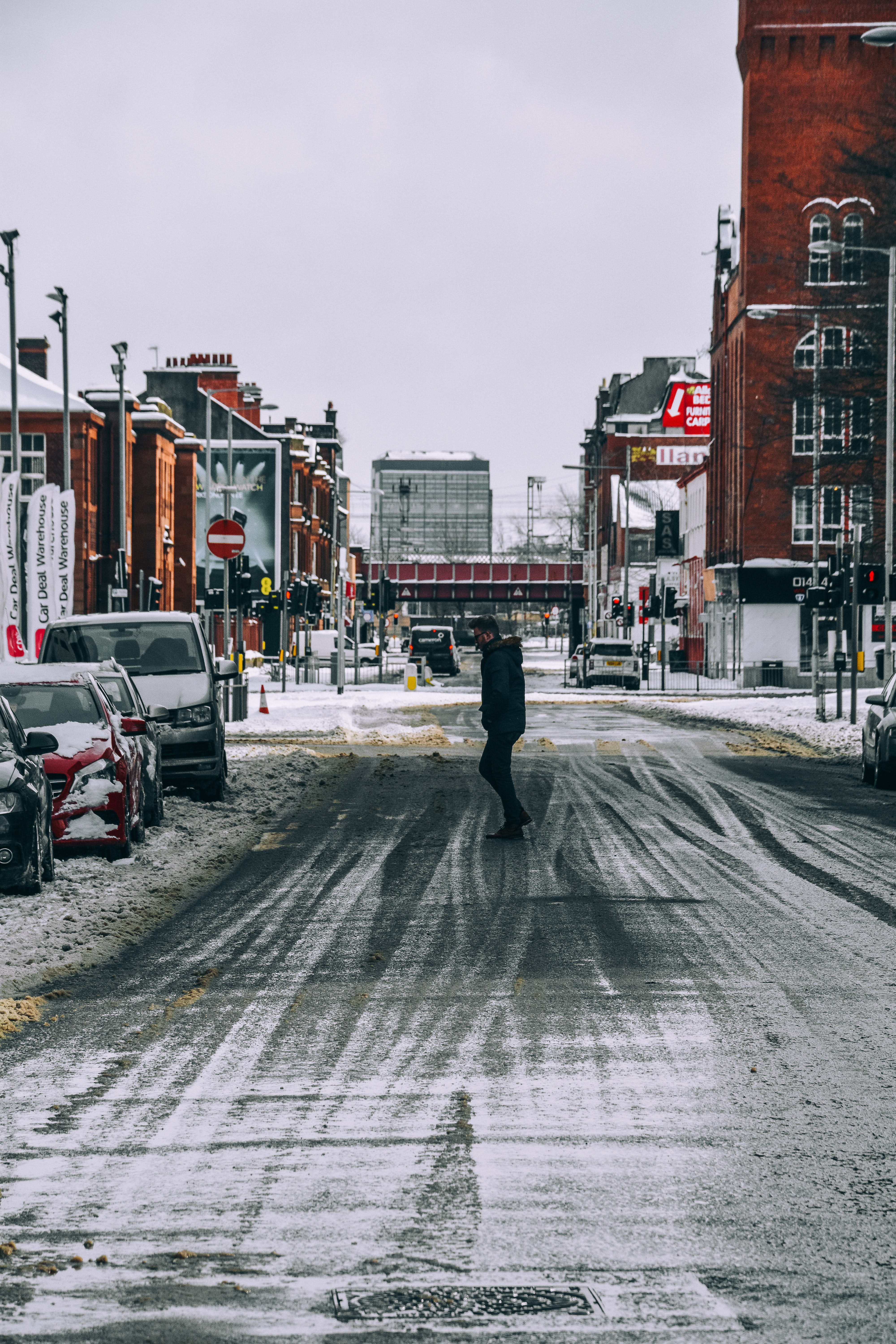 Man standing in the middle of the road photo
