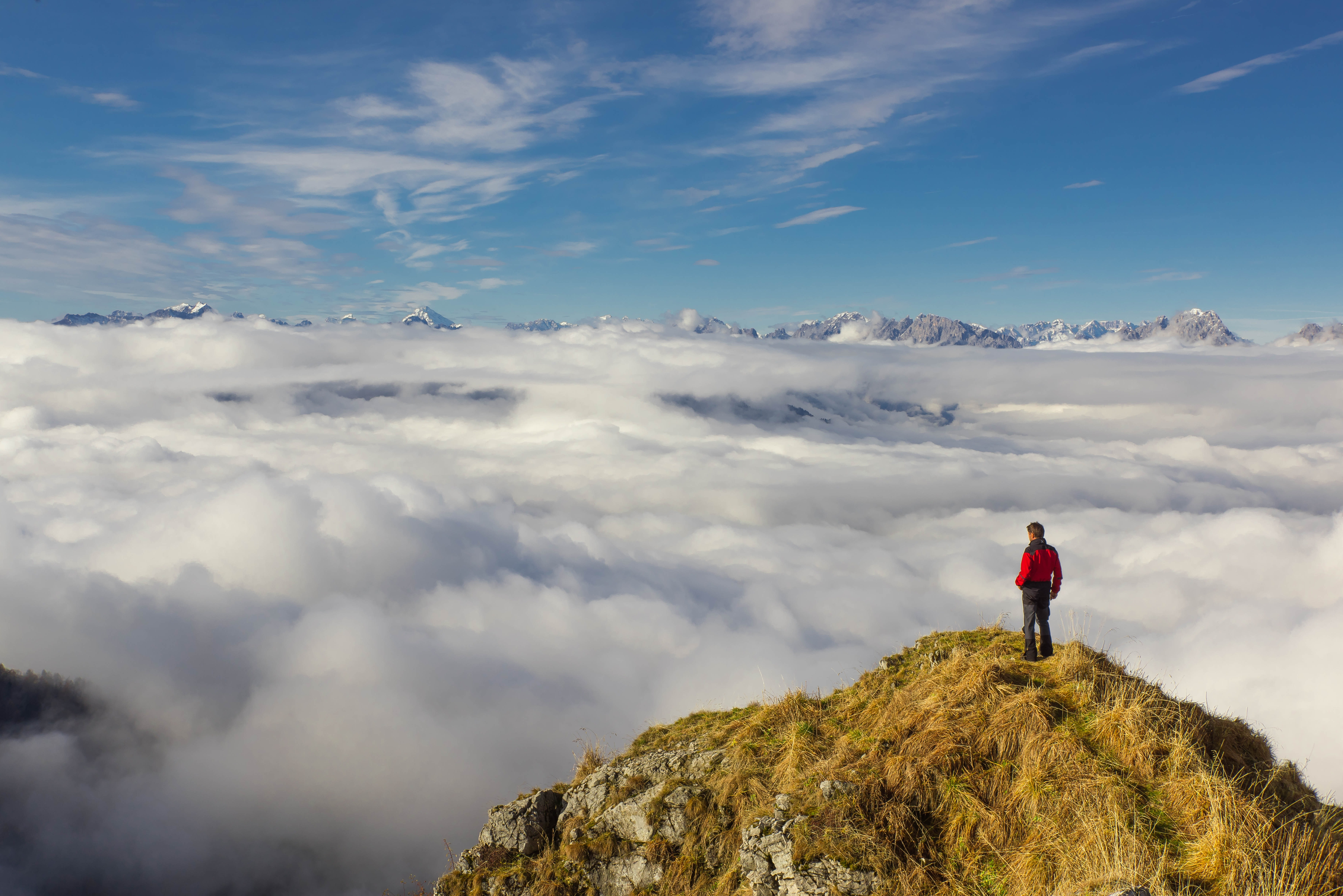 Man standing on mountain against sky photo