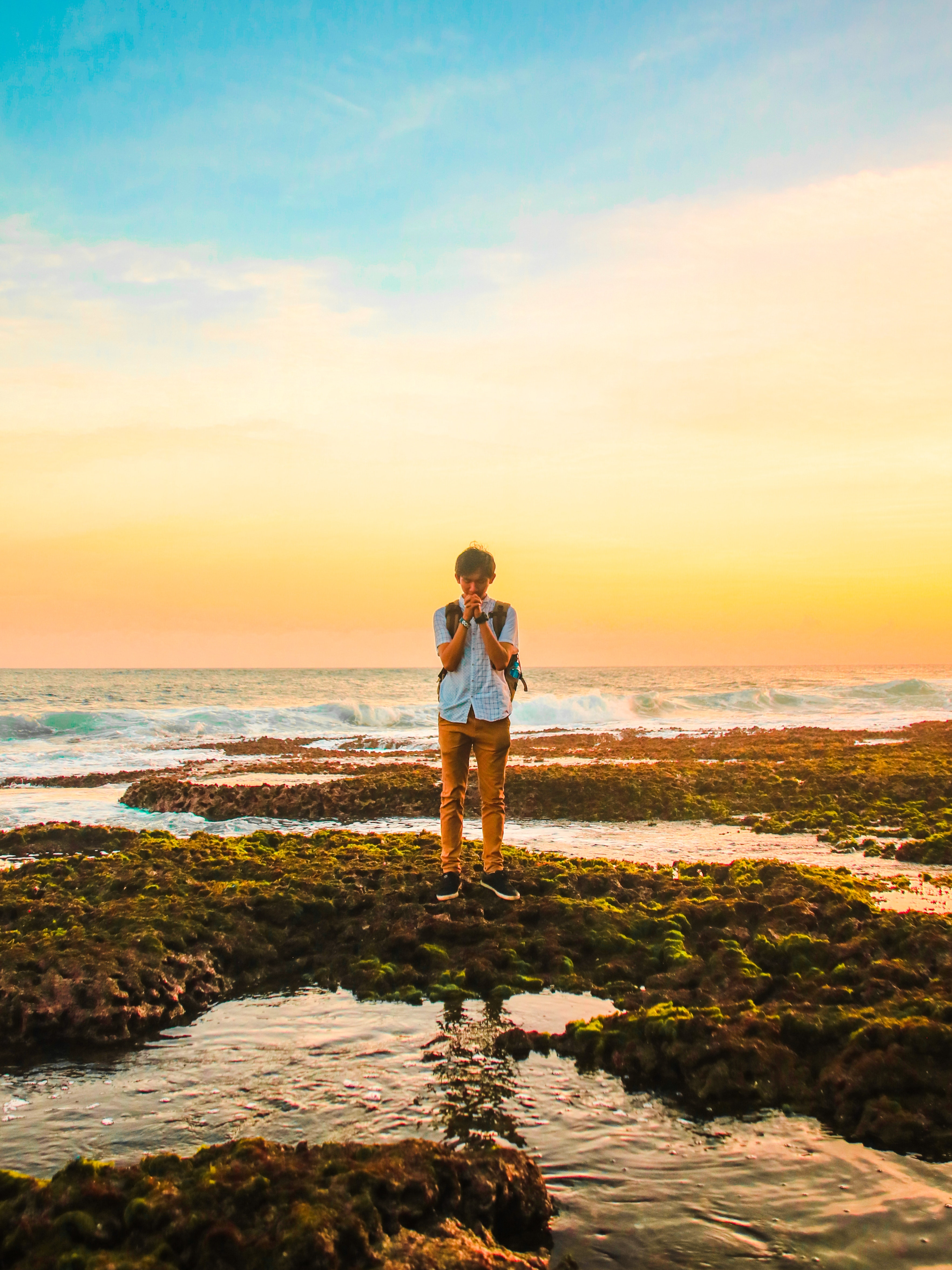 Man Standing on Rocks Near Beach during Golden Hour, Seashore, Pray, Recreation, Reflections, HQ Photo