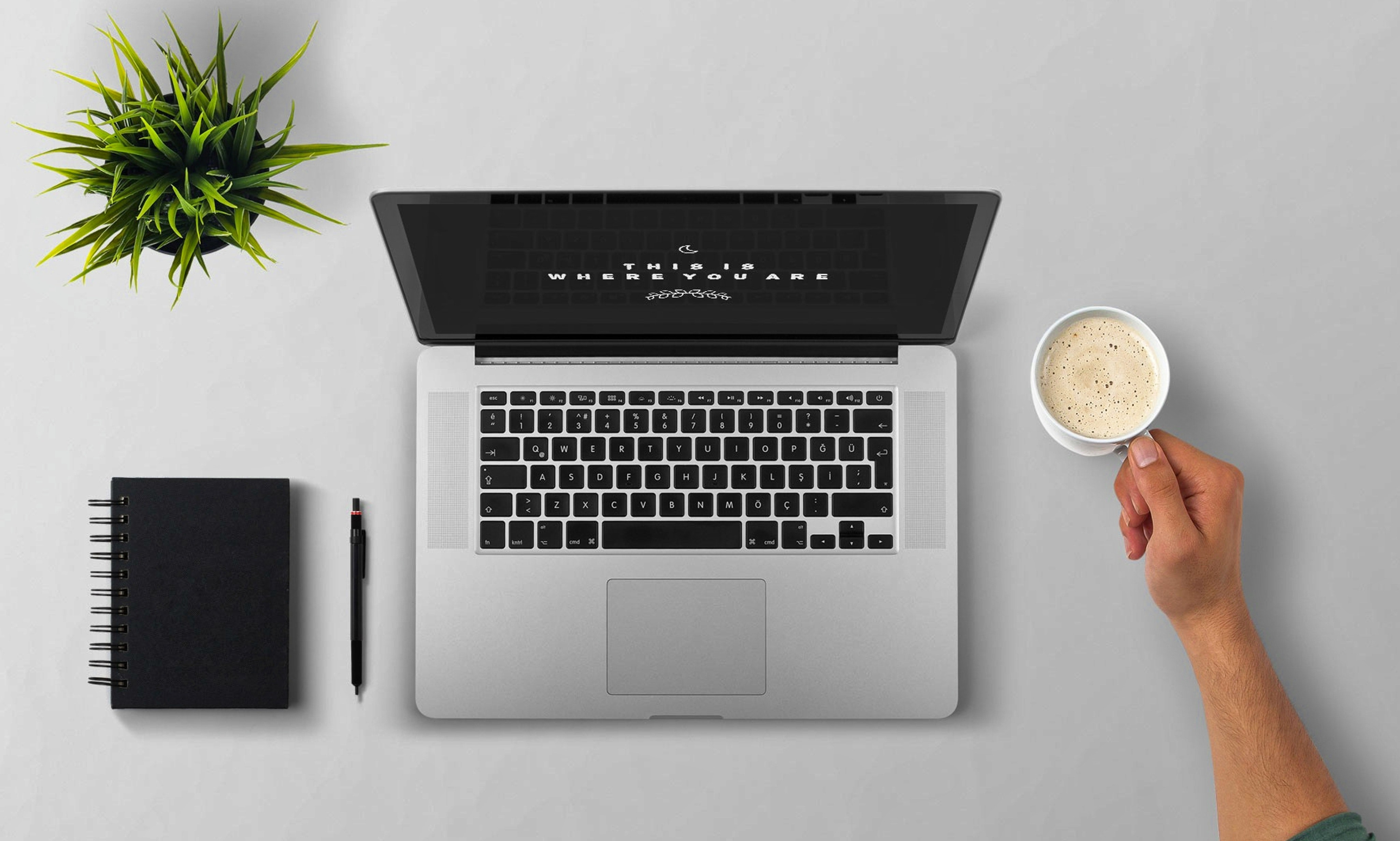 Man Using Laptop on Table Against White Background, Arm, Portable, Mug, Note pad, HQ Photo