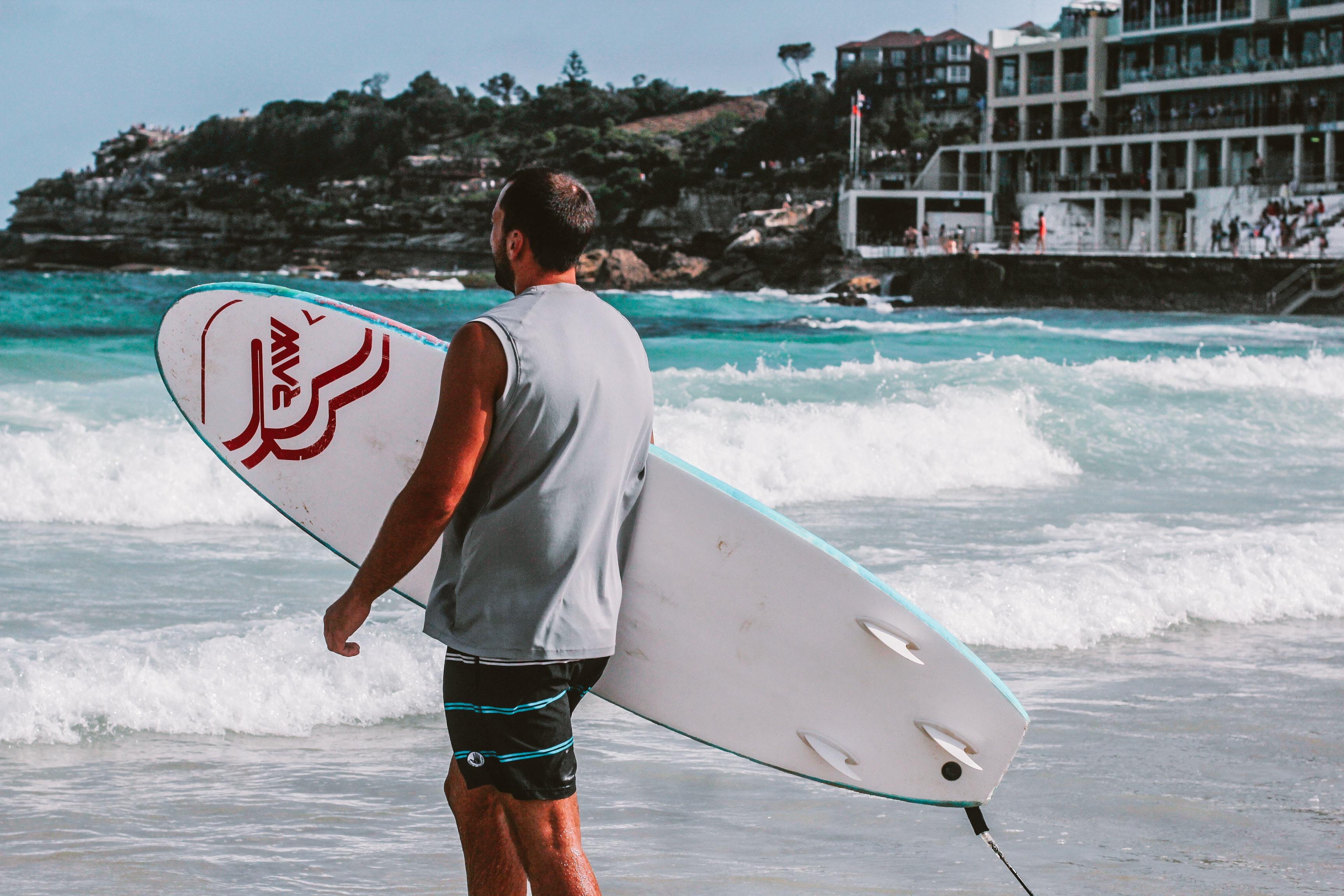 Man Walking Towards Body Of Water Holding A Surfboard, Australia, Sport, Water sports, Water, HQ Photo