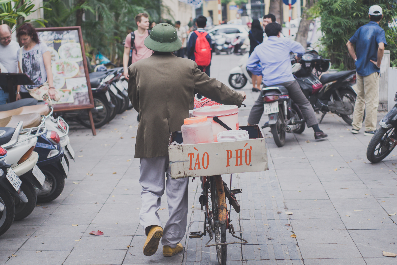 Man walking with bike photo