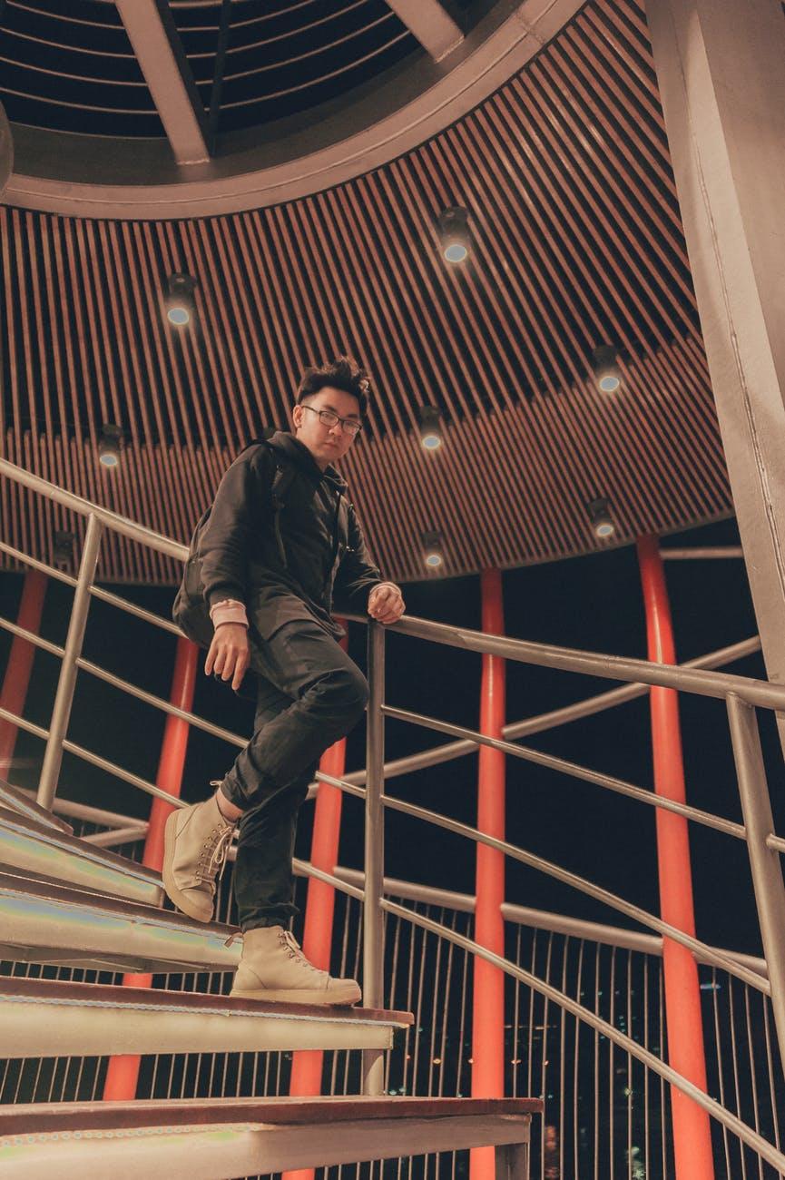 Man walks down stairs photo