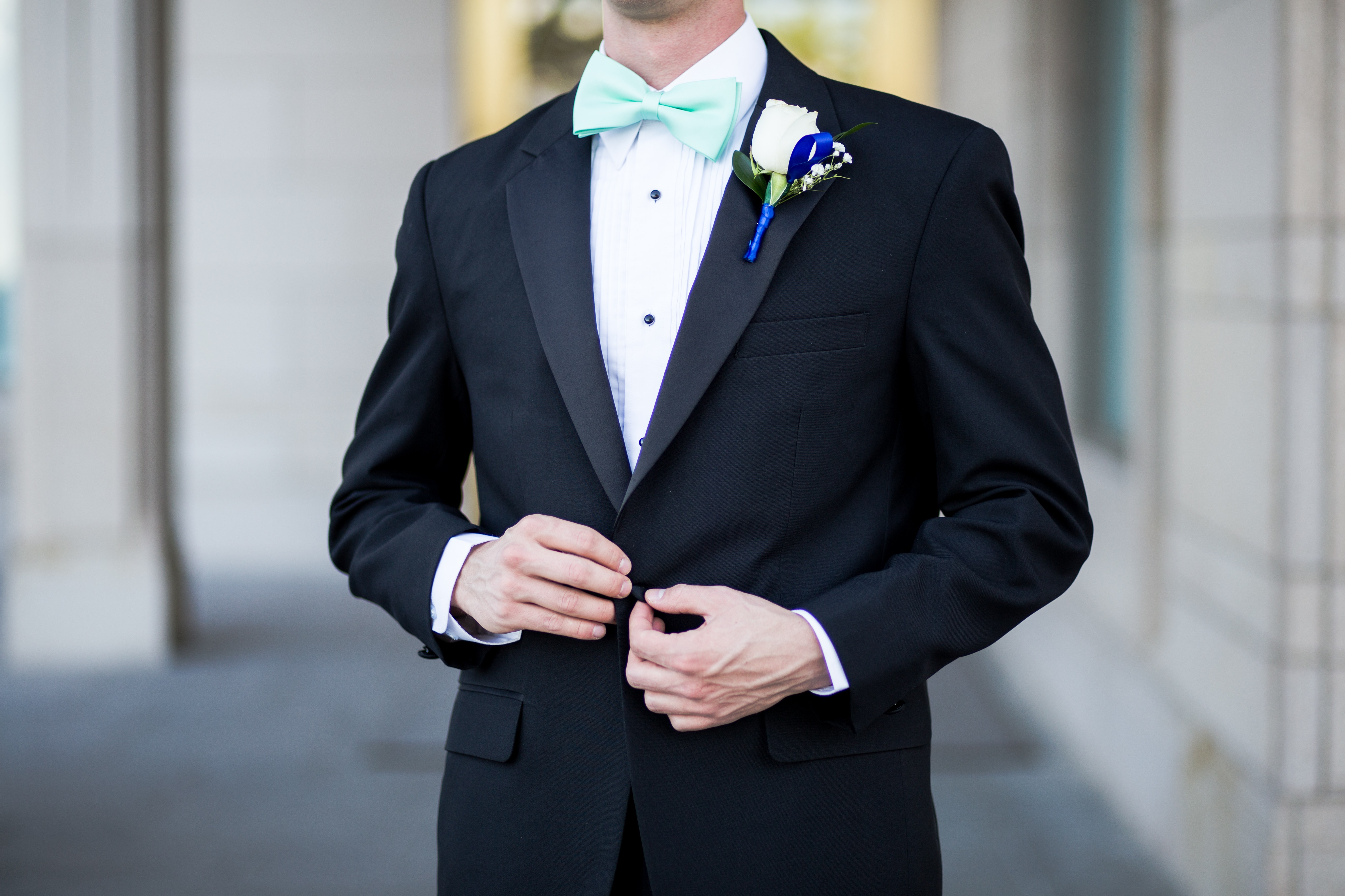 Man wearing black and teal tuxedo photo