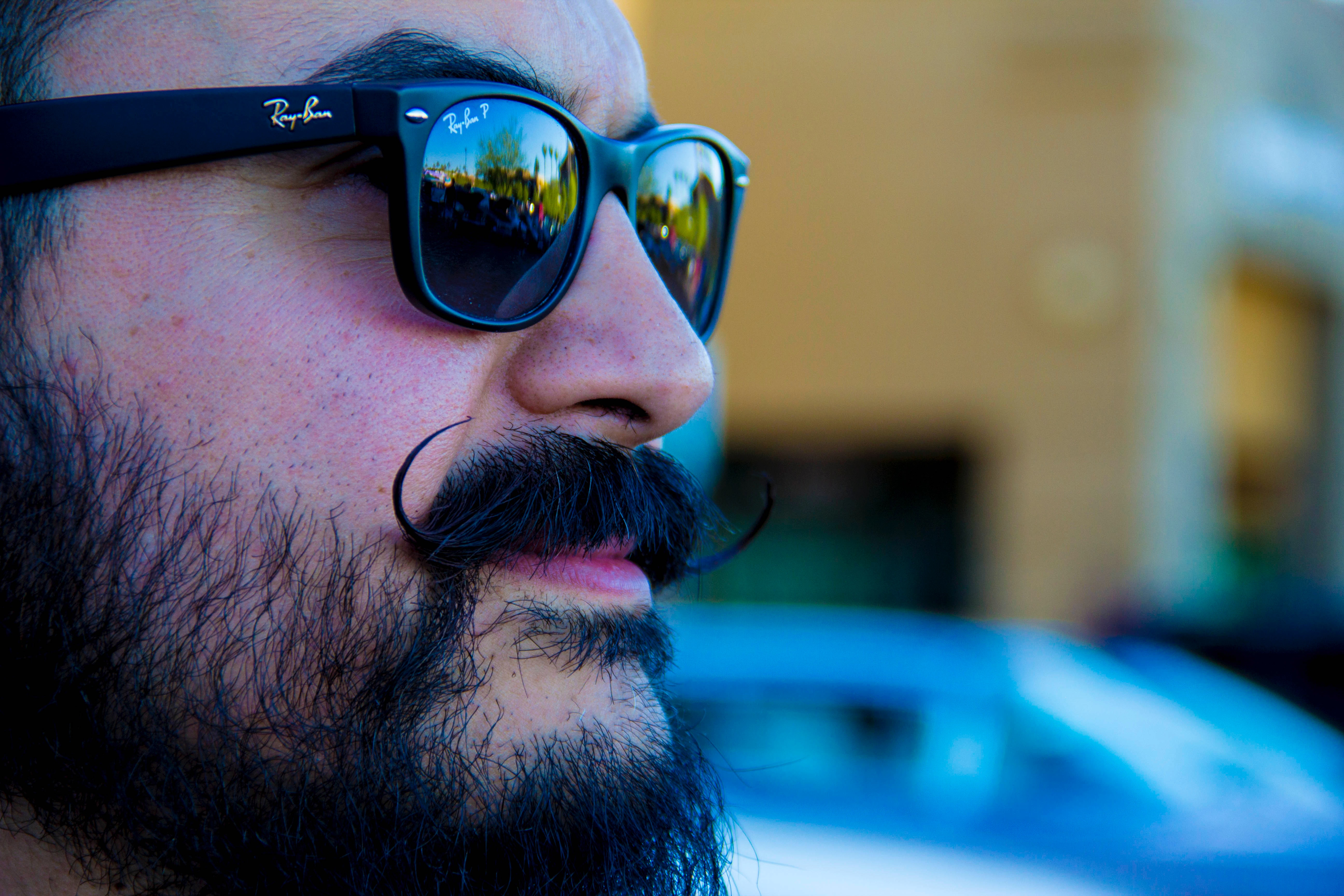 Man wearing black ray-ban wayfarer photo