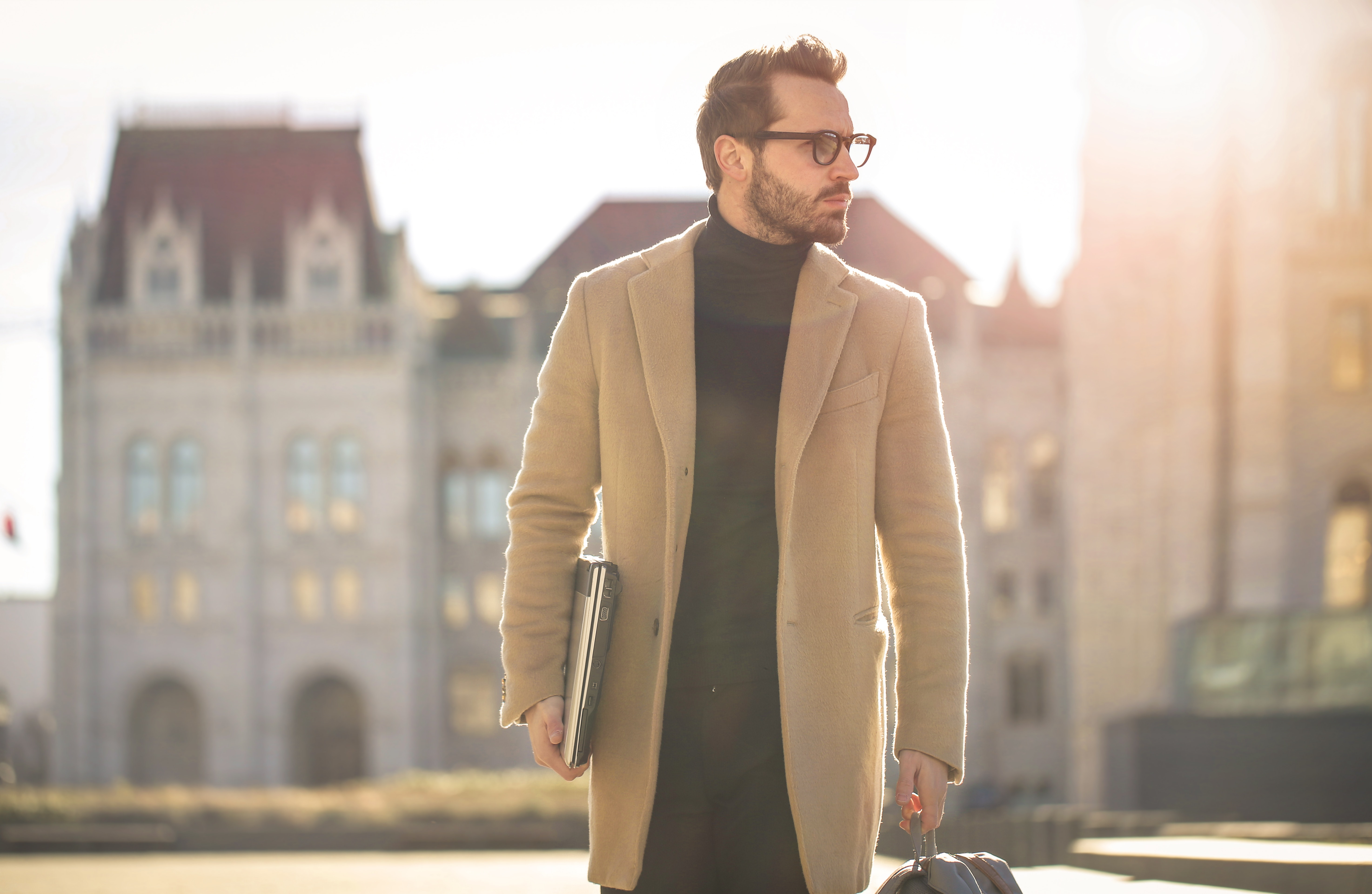 Man wearing brown coat photo