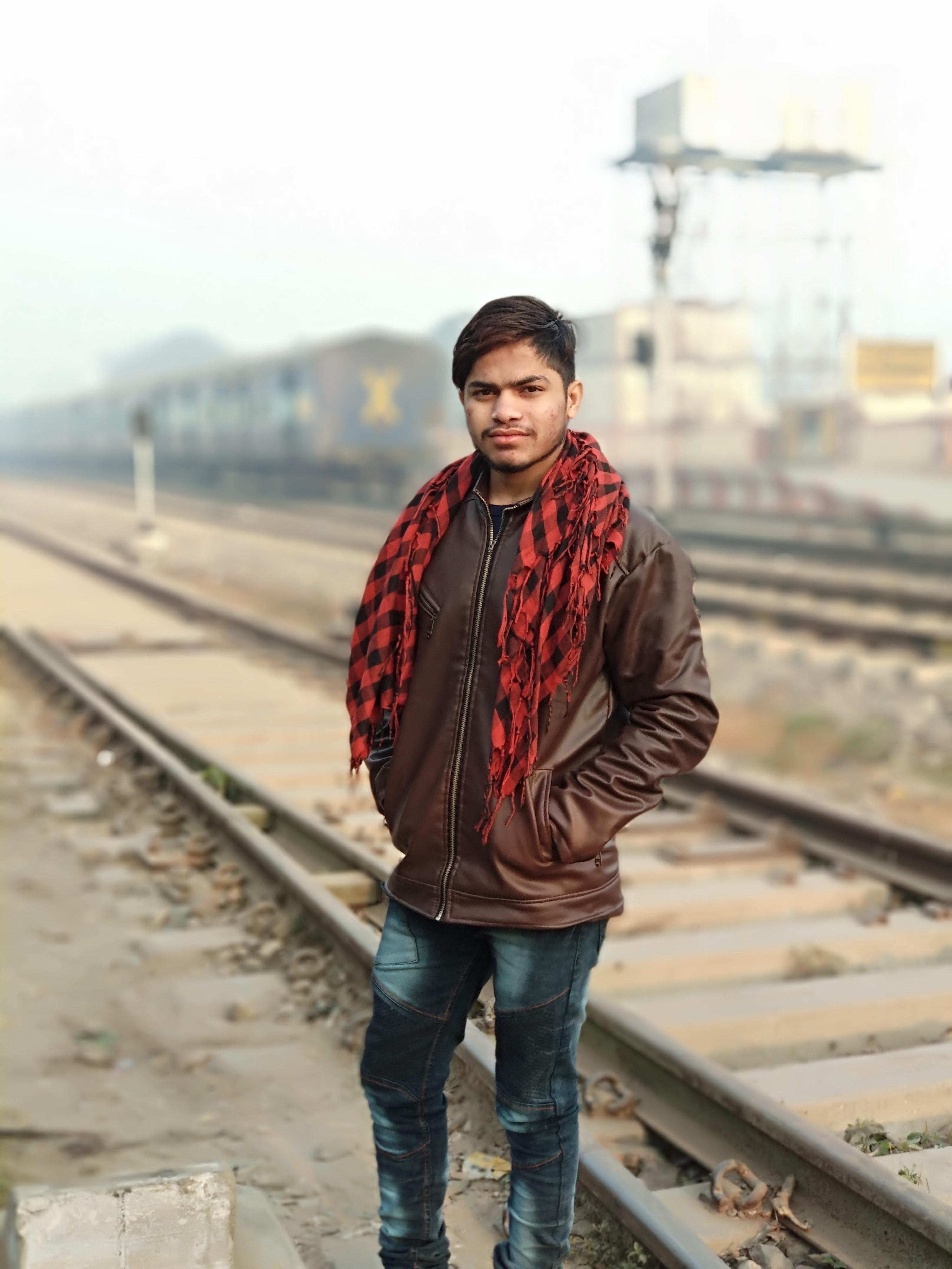 Man Wearing Brown Full-Zip Jacket, Adolescent, Railroad track, Urban, Travel, HQ Photo