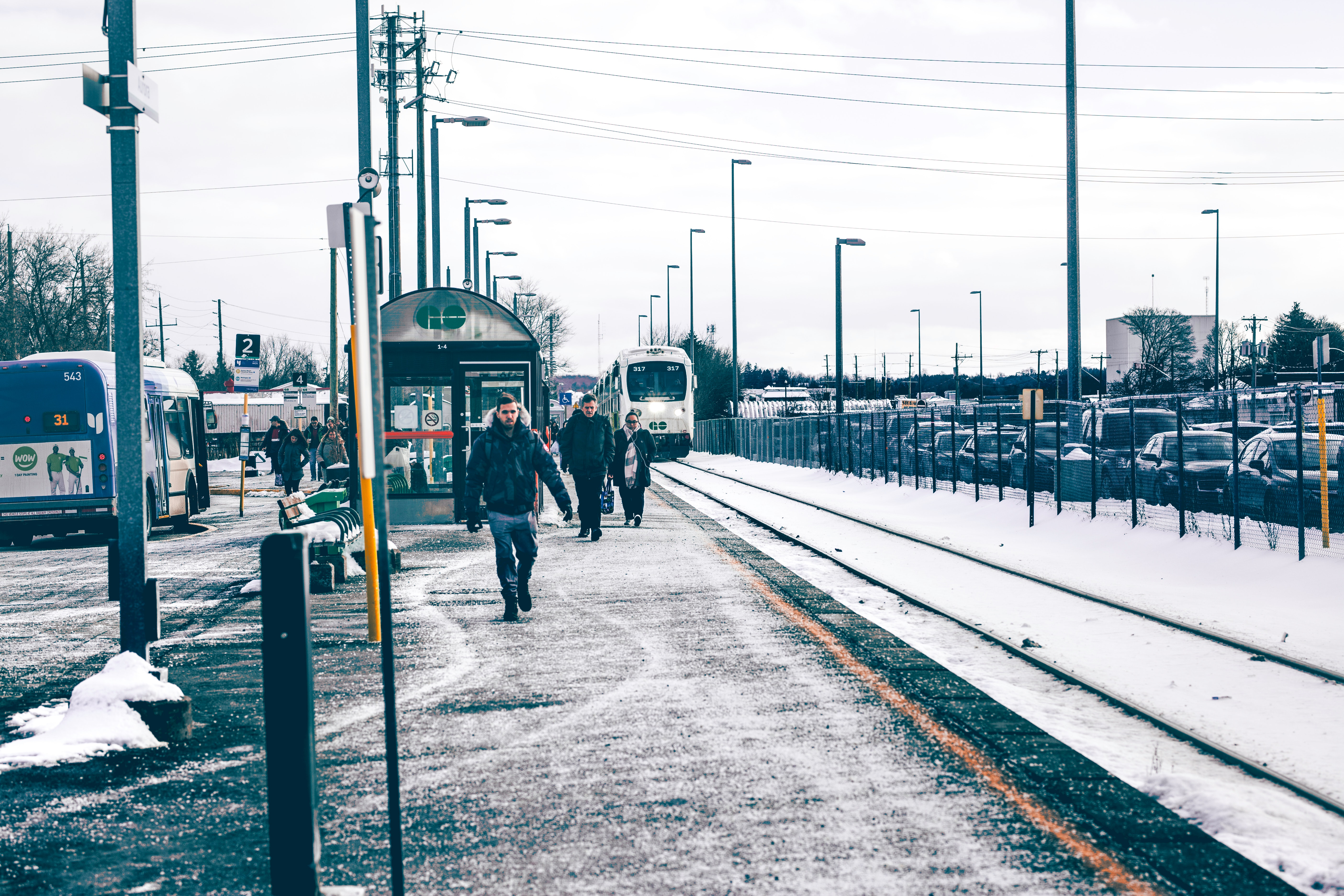 Man Wearing Jacket and Jeans Walking on Road, Road, Snow, Railway, Public, HQ Photo
