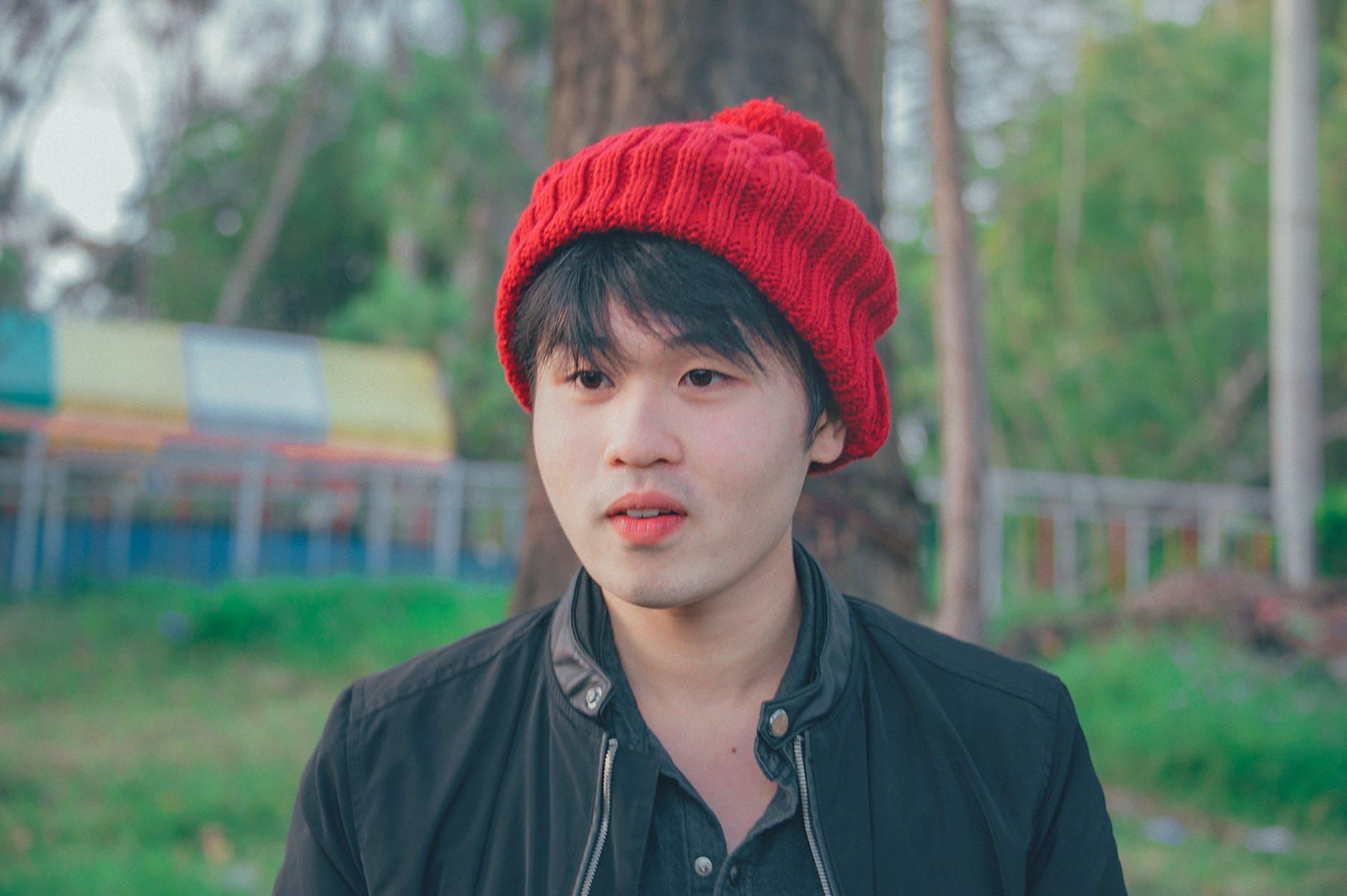 Man wearing red knit cap photo