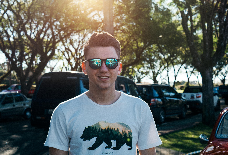 Man wearing white and black bear printed shirt and sunglasses photo