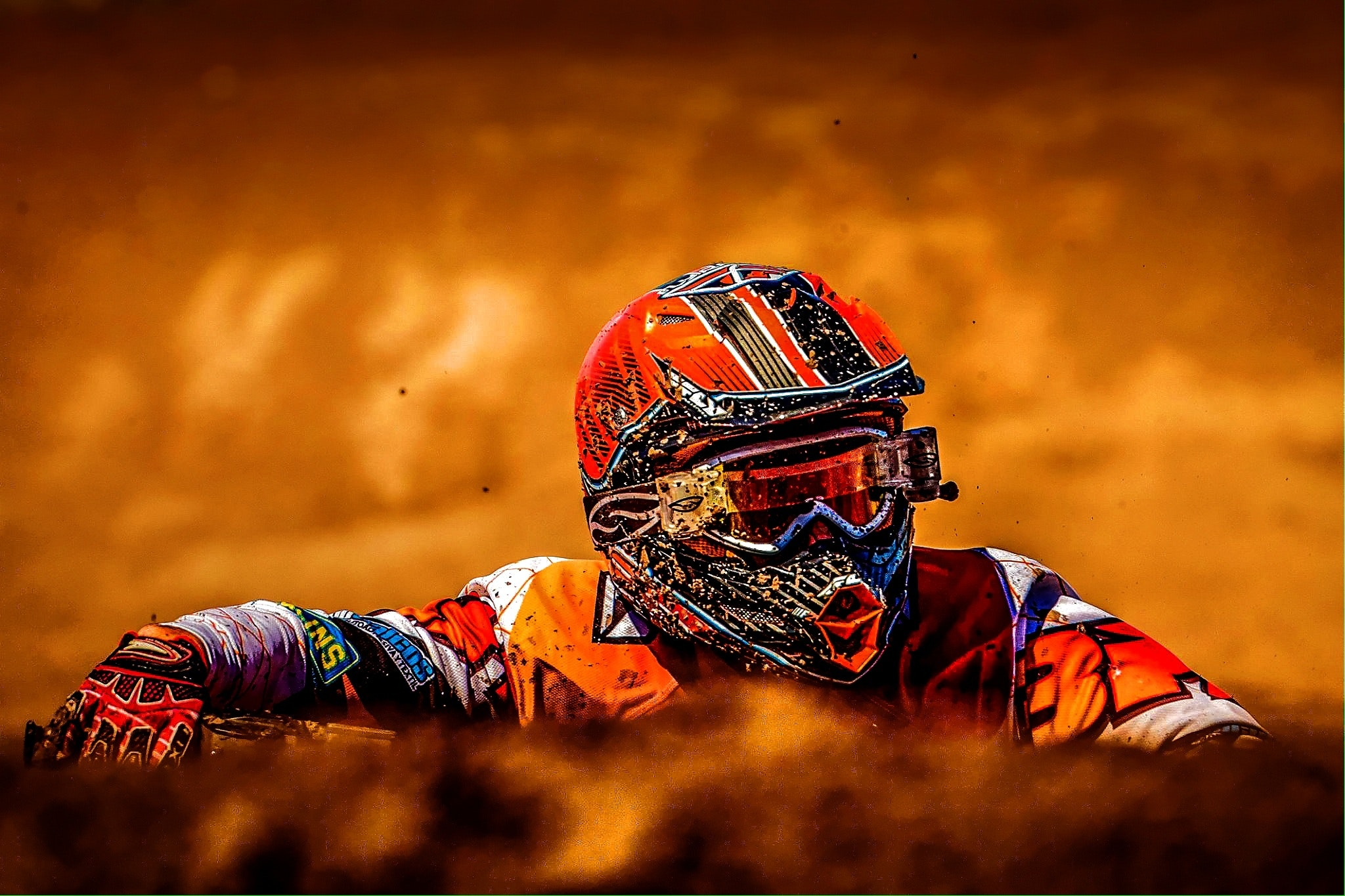 Man wearing white black and orange motorcross suit photo
