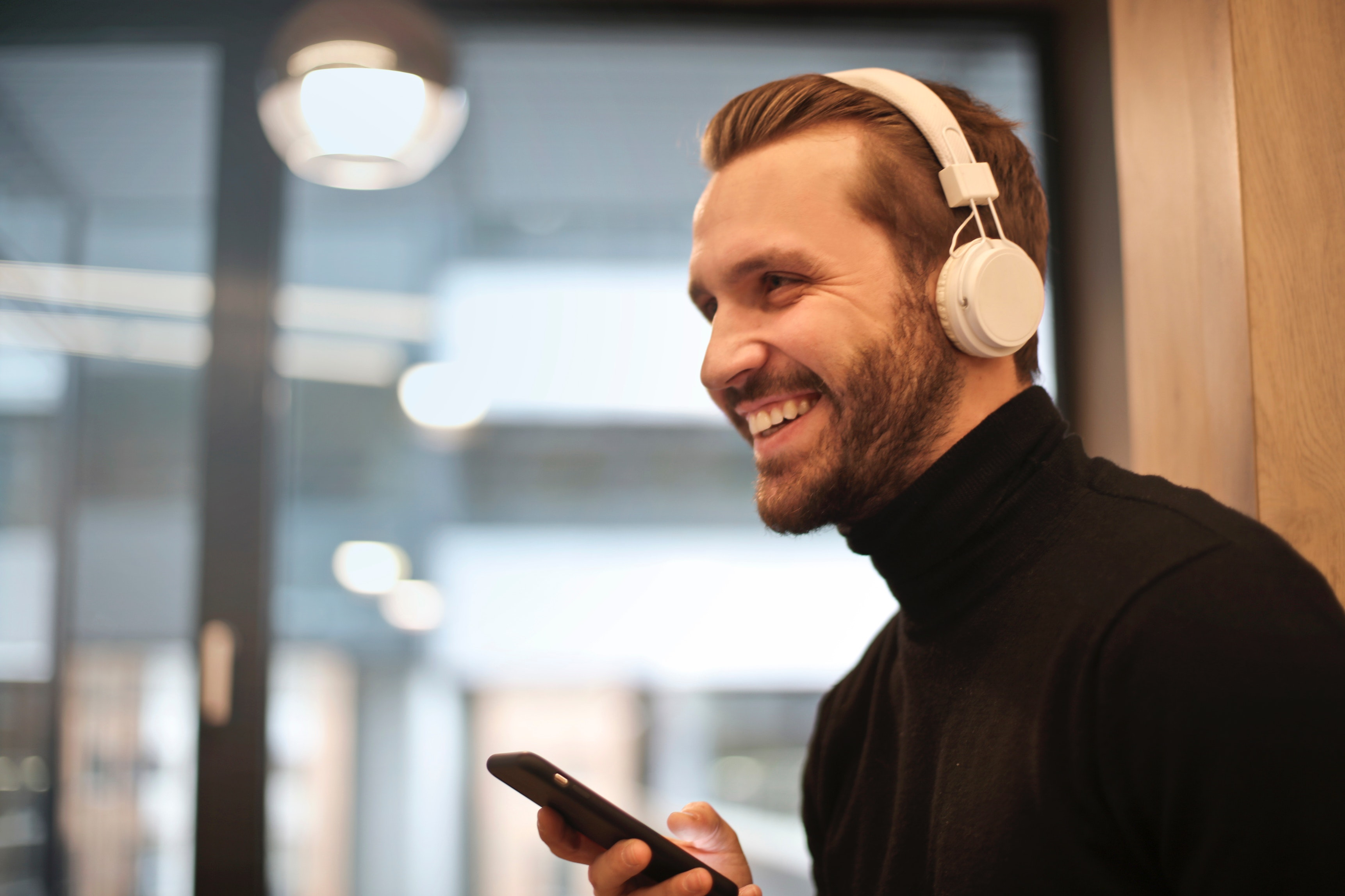 Man Wearing White Headphones Listening to Music, Bokeh, Mobile phone, Window, Touch, HQ Photo