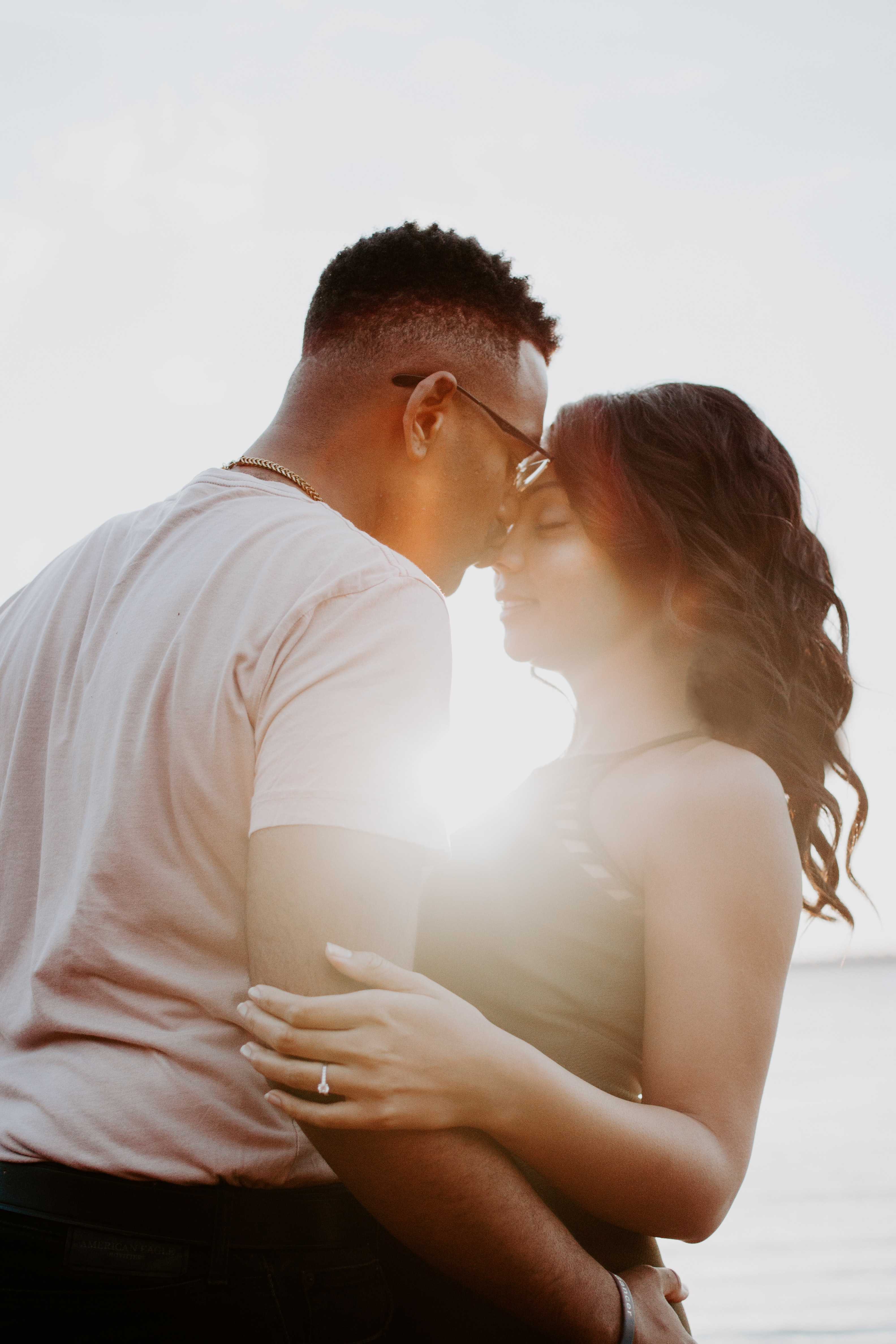 Man wearing white shirt kissing woman in her nose photo