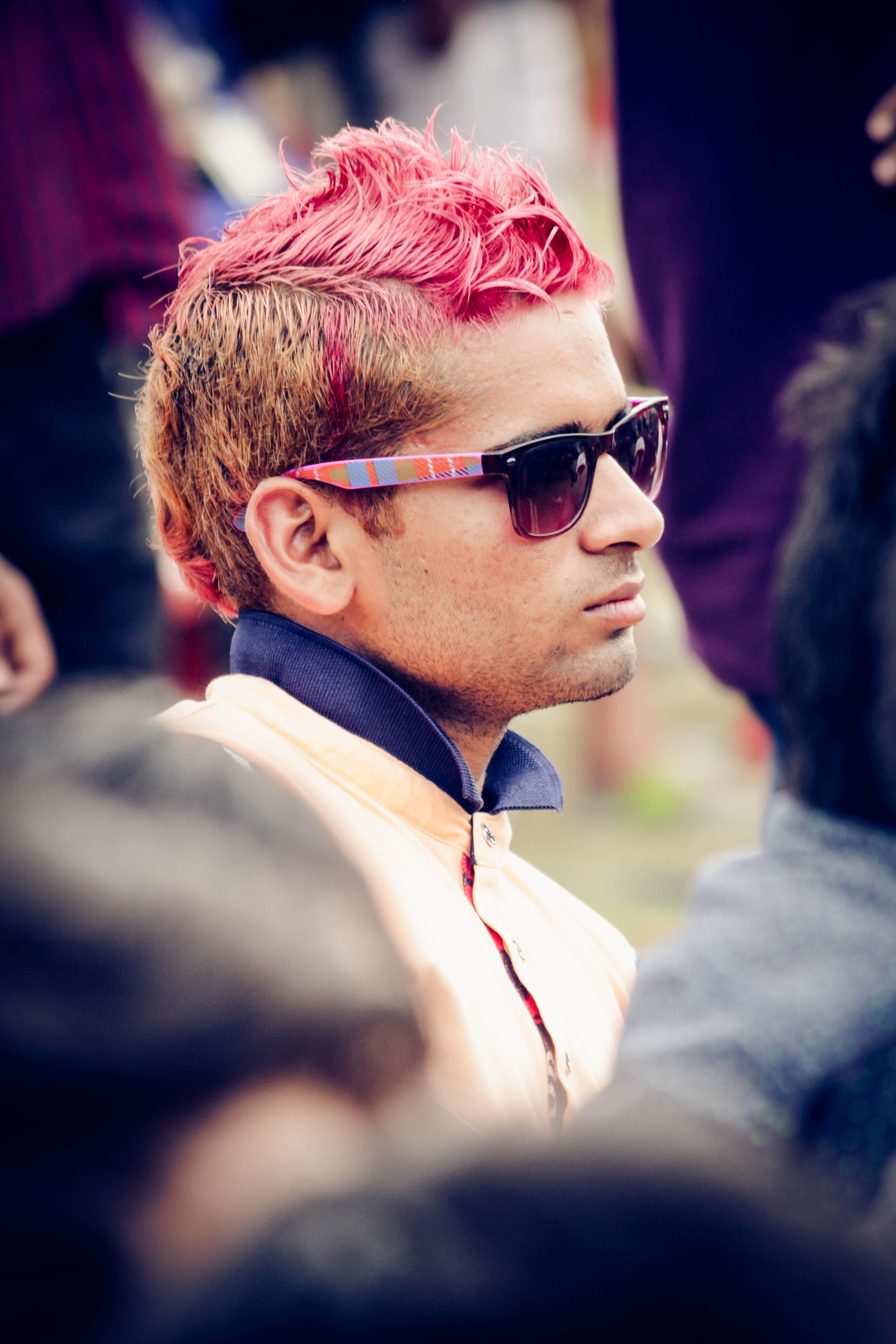 Man wearing white top and black wayfarer sunglasses photo