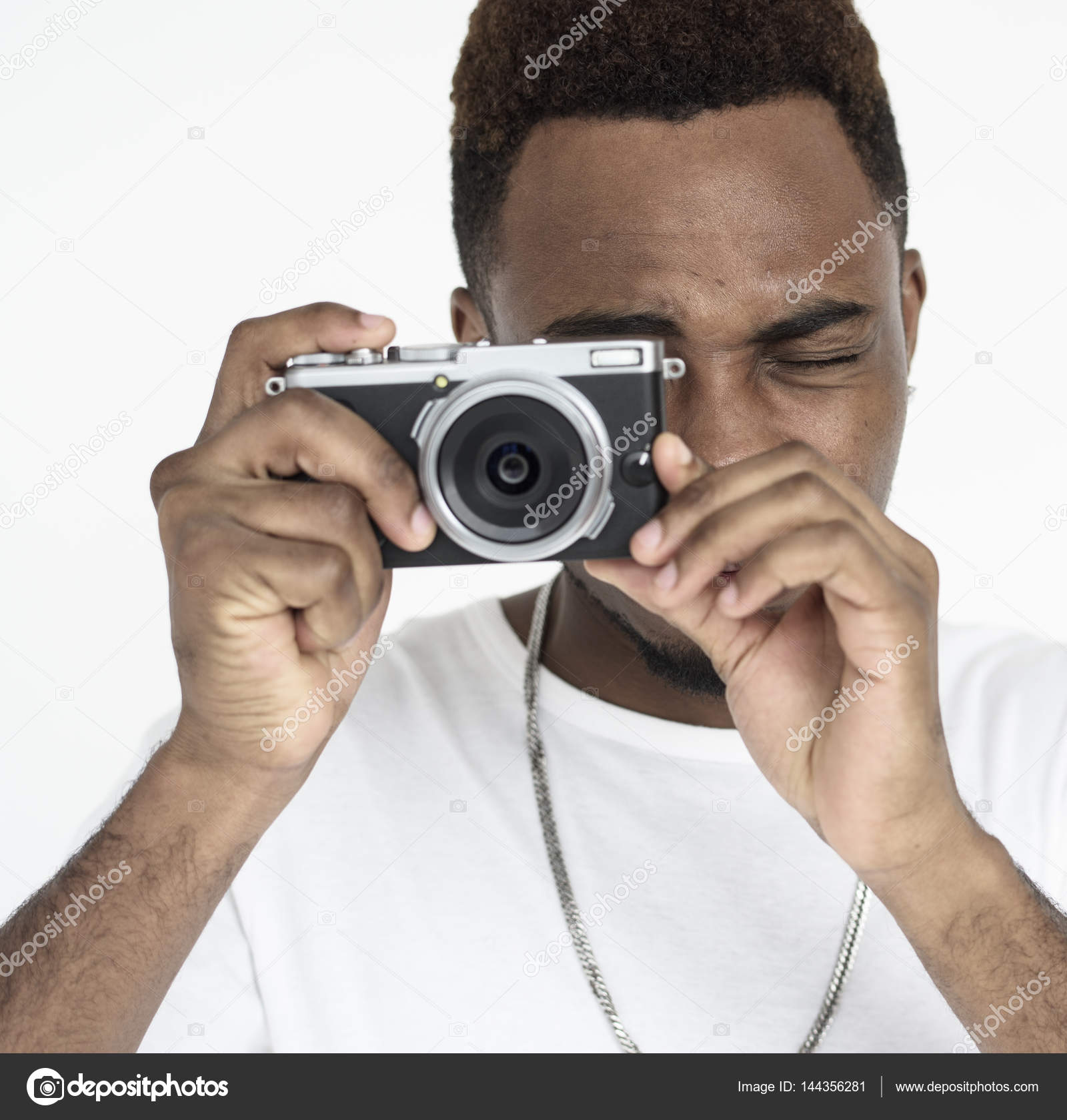young African man with camera — Stock Photo © Rawpixel #144356281