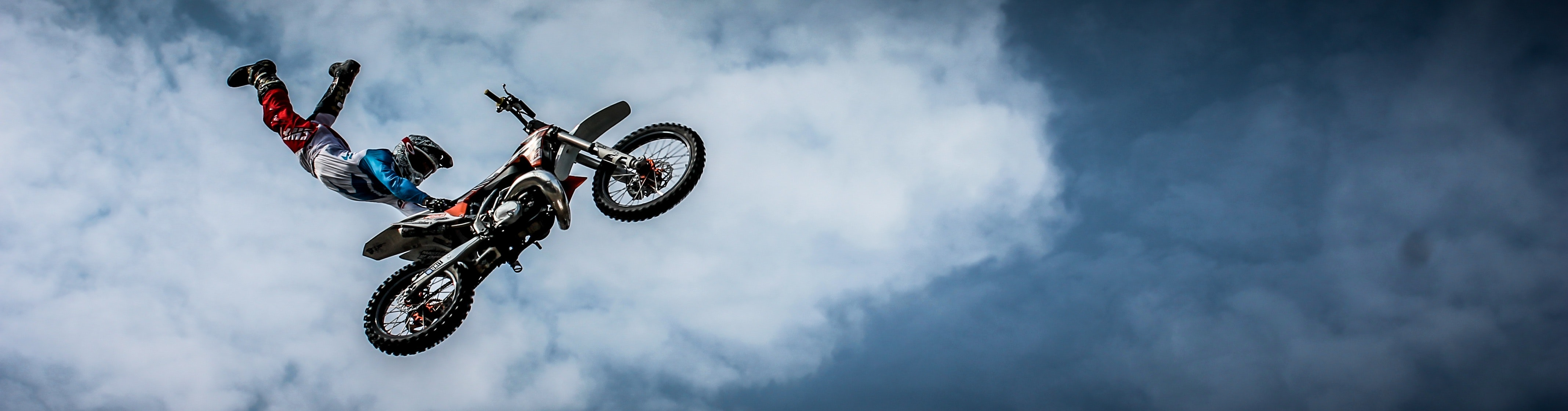 Man with off road motorcycle doing tricks photo