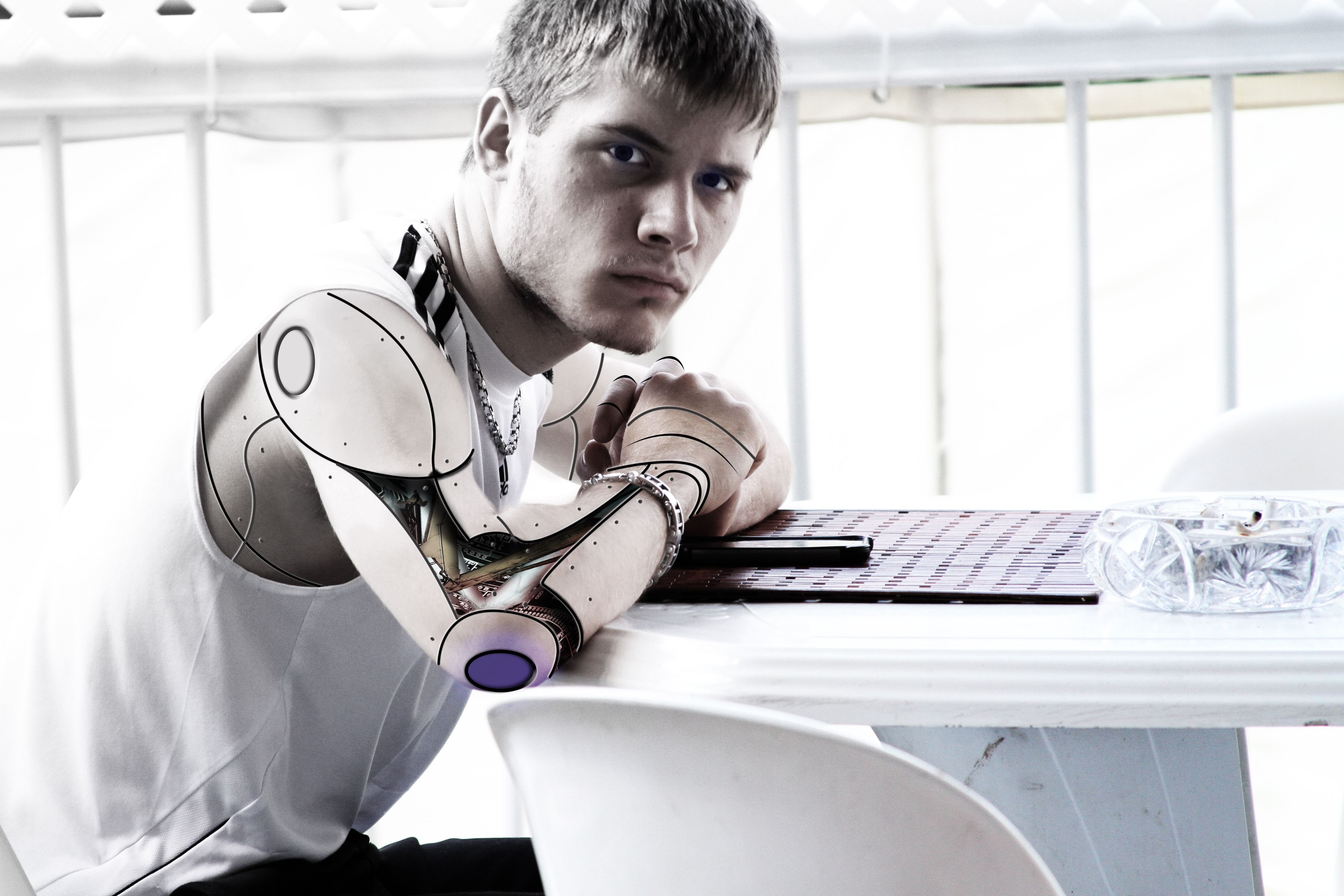 Man With Steel Artificial Arm Sitting in Front of White Table, Ai, Man, Technology, Science, HQ Photo