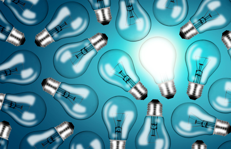 Many lightbulbs on blue background - ideas and creativity concept photo